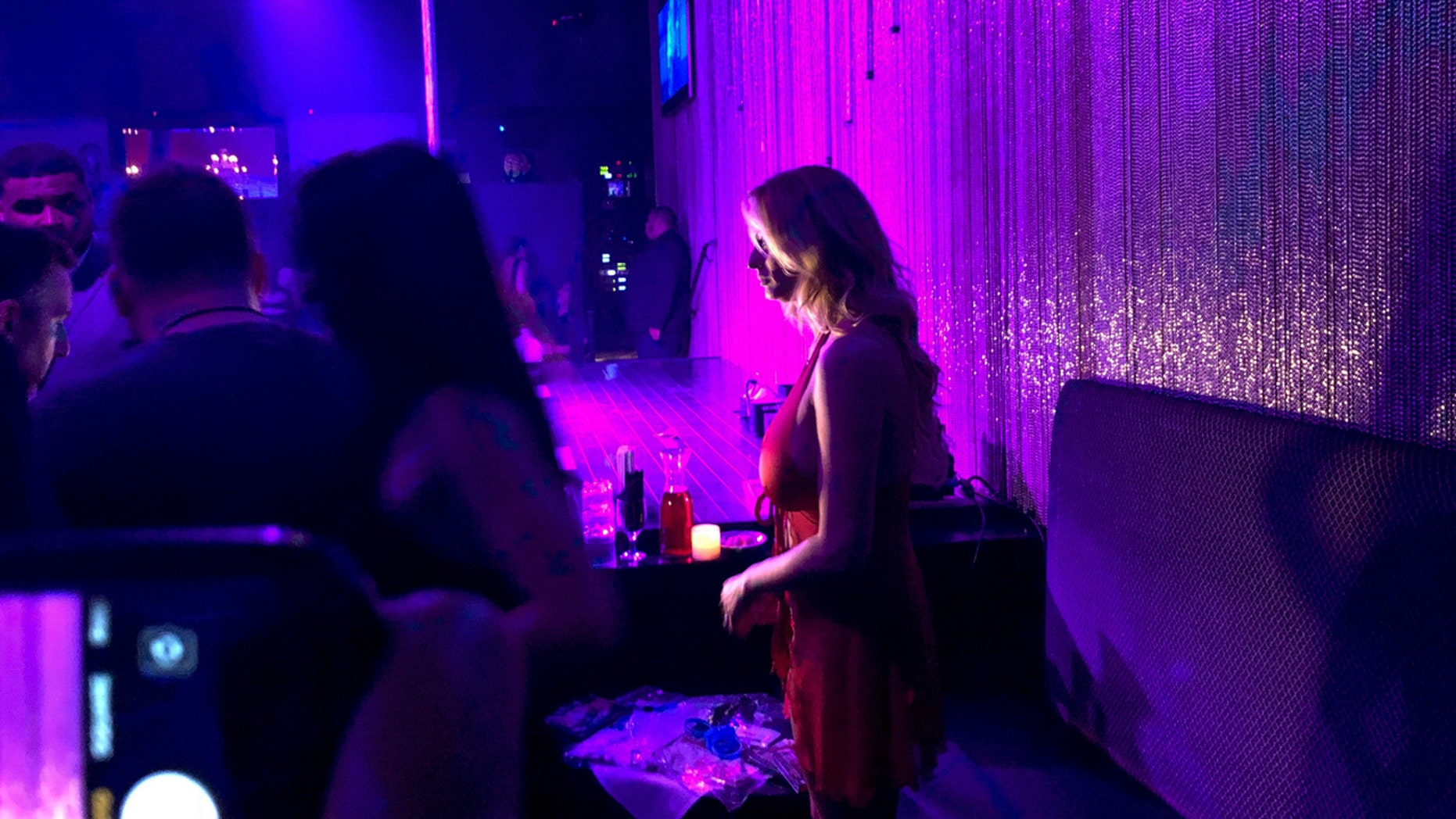 """Stormy Daniels holds a meet-and-greet with patrons during her appearance at the strip club Gossip on Saturday, May 5, 2018, in Melville, New York.  President Donald Trump suggested Friday that Rudy Giuliani, the aggressive new face of his legal team, needed to """"get his facts straight"""" about the hush money paid to porn actress Daniels just before the 2016 election. The money was paid to Daniels to keep her quiet about her allegations of an affair with Trump. (AP Photo/Kevin Hagen)"""