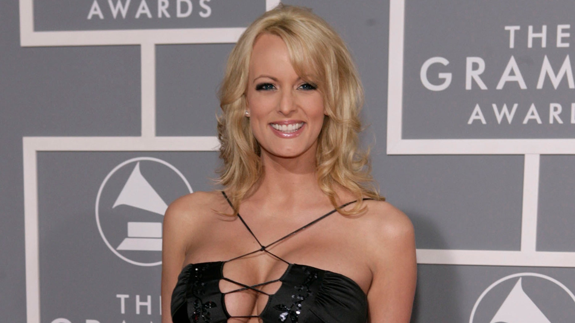 FILE - In this Feb. 11, 2007, file photo, Stormy Daniels arrives for the 49th Annual Grammy Awards in Los Angeles. Daniels who had previously alleged an extramarital affair with Donald Trump now says in a statement the affair never happened. A lawyer for porn actress Stormy Daniels confirmed his client's statement on Jan. 30, 2018. Daniels' real name is Stephanie Clifford.(AP Photo/Matt Sayles, File)