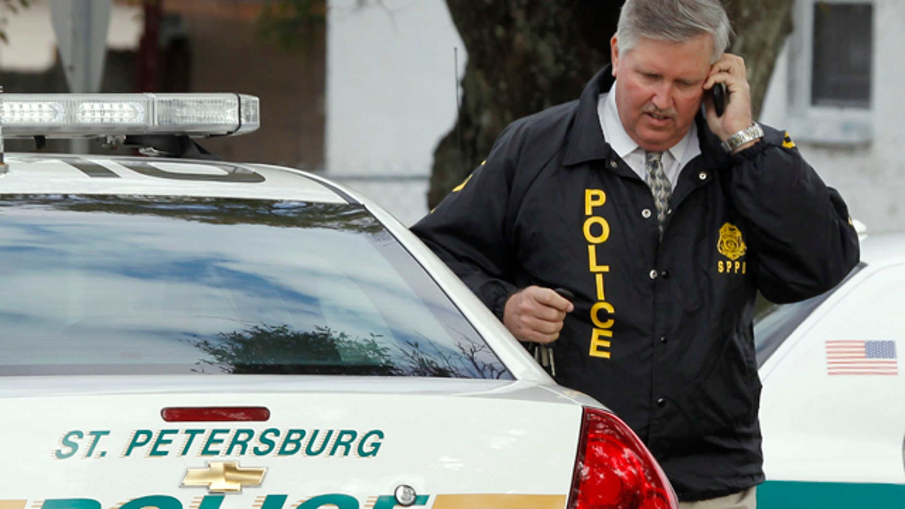 Jan. 24: St. Petersburg Police Chief Chuck Harmon talks on a cell phone as he walks from the scene where a U.S. Marshal and two St. Petersburg police officers were shot while trying to serve an arrest warrant in St. Petersburg, Fla. (AP)