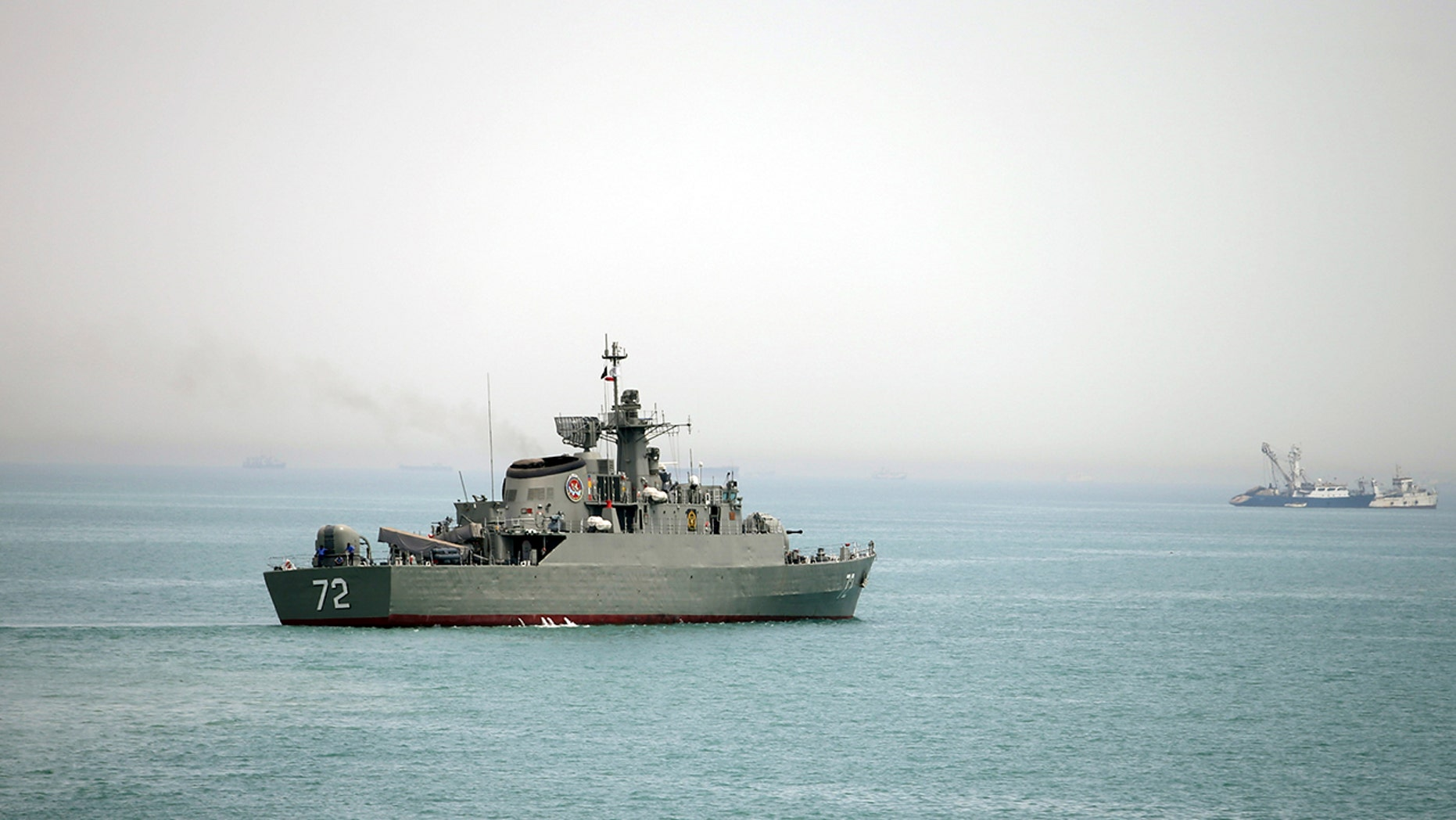 Iran began a large-scale exercise in the Strait of Hormuz involving more than 50 small boats that is expected to last several hours.