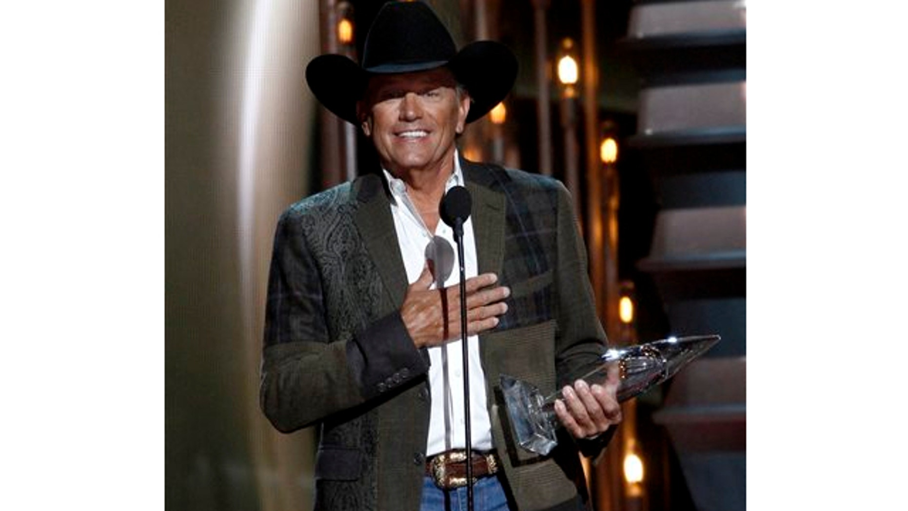 Nov. 6, 2013: George Strait accepts the award for entertainer of the year at the 47th annual CMA Awards at Bridgestone Arena in Nashville, Tenn.