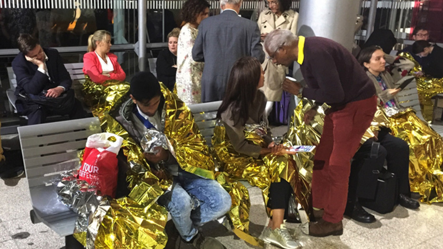 Sept. 2: Passengers wrapped in thermal foil blankets given out by emergency services after their Eurostar train was stranded at Calais Station, after intruders were seen near the Eurotunnel, in Calais, France.