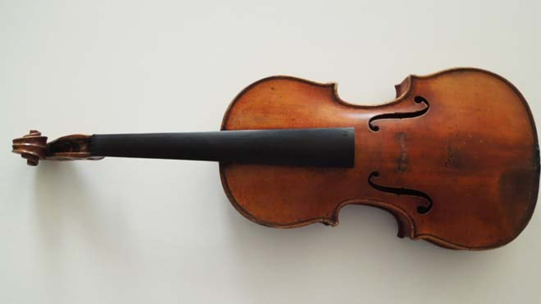 This handout photo provided by the FBI New York shows The Ames Stradivarius which was recovered by the FBI in June. Renowned violinist Roman Totenberg left his beloved Stradivarius in his office while greeting well-wishers after a concert in 1980. When he returned, it was gone.