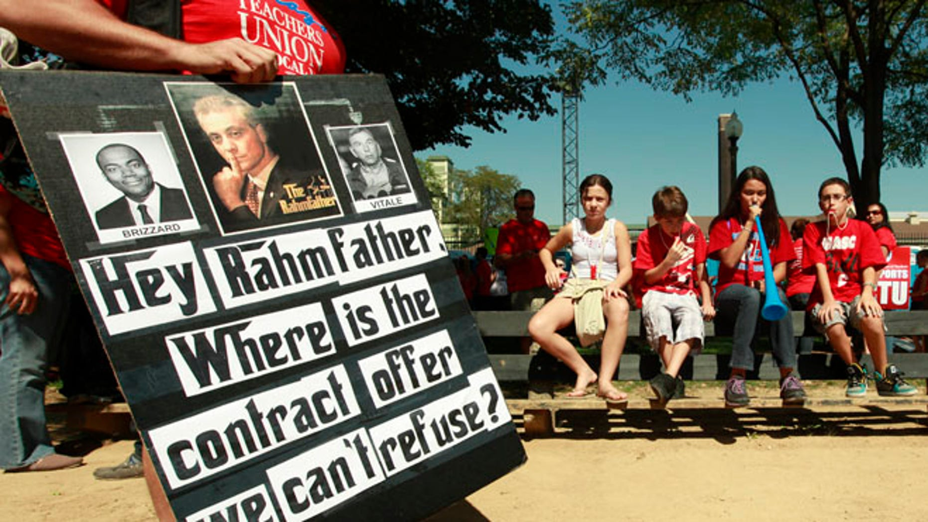 Sept. 15, 2012: A protester holds a sign critical of Chicago mayor Rahm Emanuel during a rally of striking Chicago school teachers in Chicago.