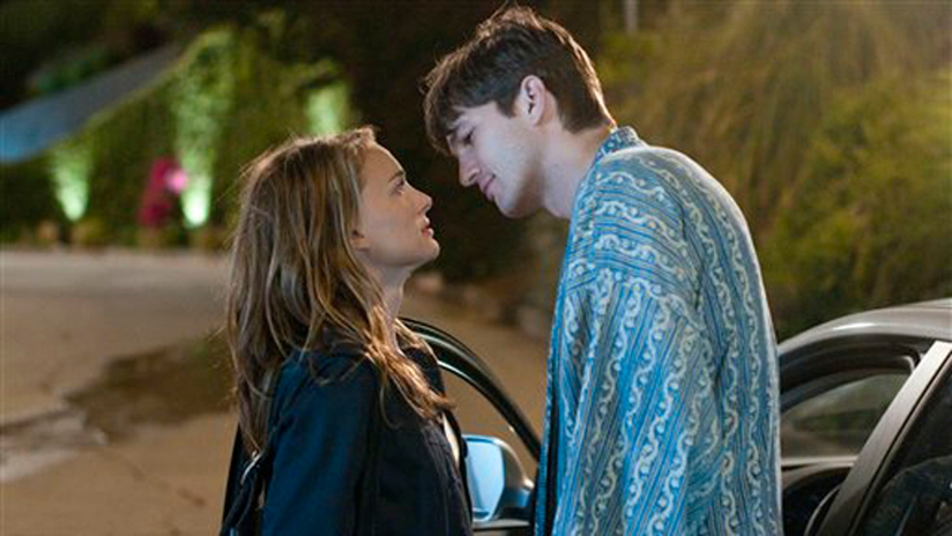 """In this film publicity image released by Paramount, Ashton Kutcher, right, and Natalie Portman are shown in a scene from """"No Strings Attached."""""""