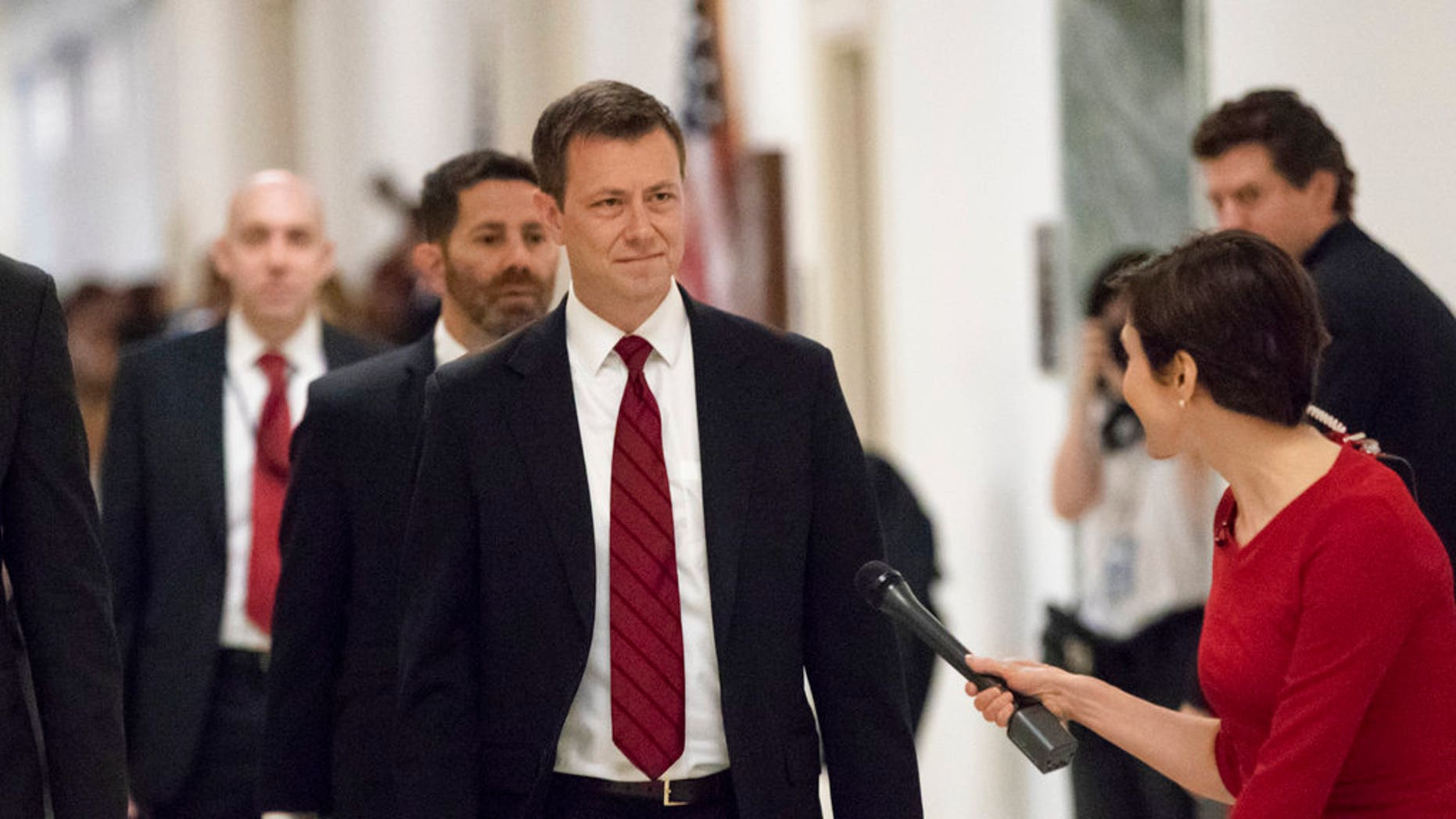 "FILE - In this June 27, 2018, file photo, Peter Strzok, the FBI agent facing criticism following a series of anti-Trump text messages, walks to gives a deposition before the House Judiciary Committee on Capitol Hill in Washington. Strzok, whose anti-Trump text messages fueled suspicions of partisan bias will tell lawmakers July 12 that his law enforcement work has never been tainted by political considerations and that the intense congressional scrutiny of him represents ""just another victory notch in Putin's belt,"" according to prepared remarks obtained by The Associated Press.(AP Photo/J. Scott Applewhite, File)"