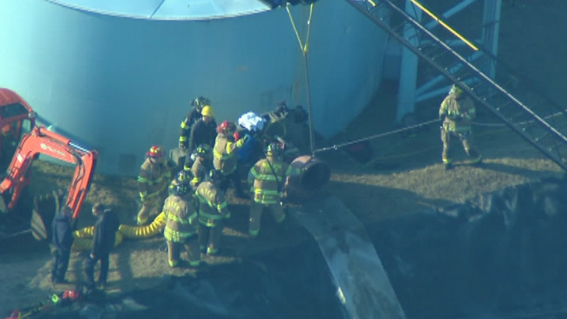Authorities working to free a person stuck in a pipe at a water facility in Manalapan Township, which is south east of Princeton.