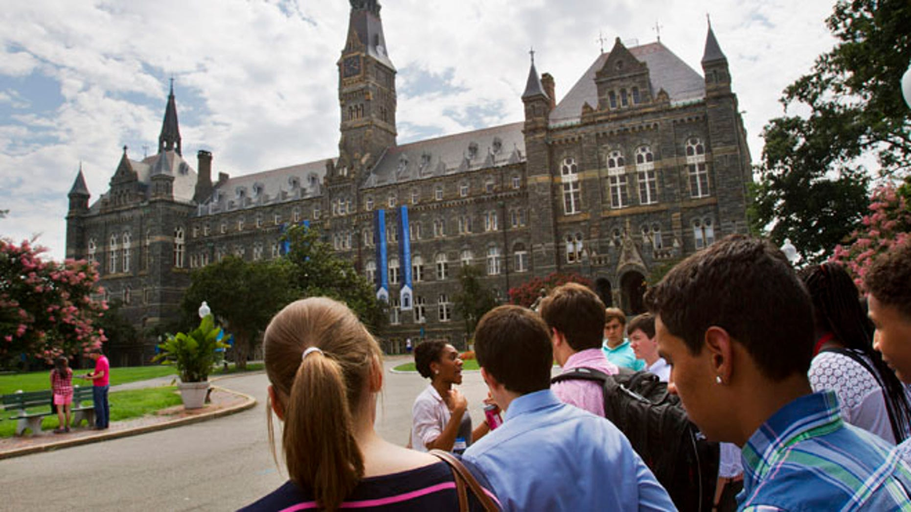 Prospective students tour Georgetown University's campus in Washington, in this Wednesday, July 10, 2013, file photo. Grants and scholarships are taking a leading role in paying college bills, surpassing the traditional role parents long have played in helping foot the bills, according to a report from loan giant Sallie Mae.