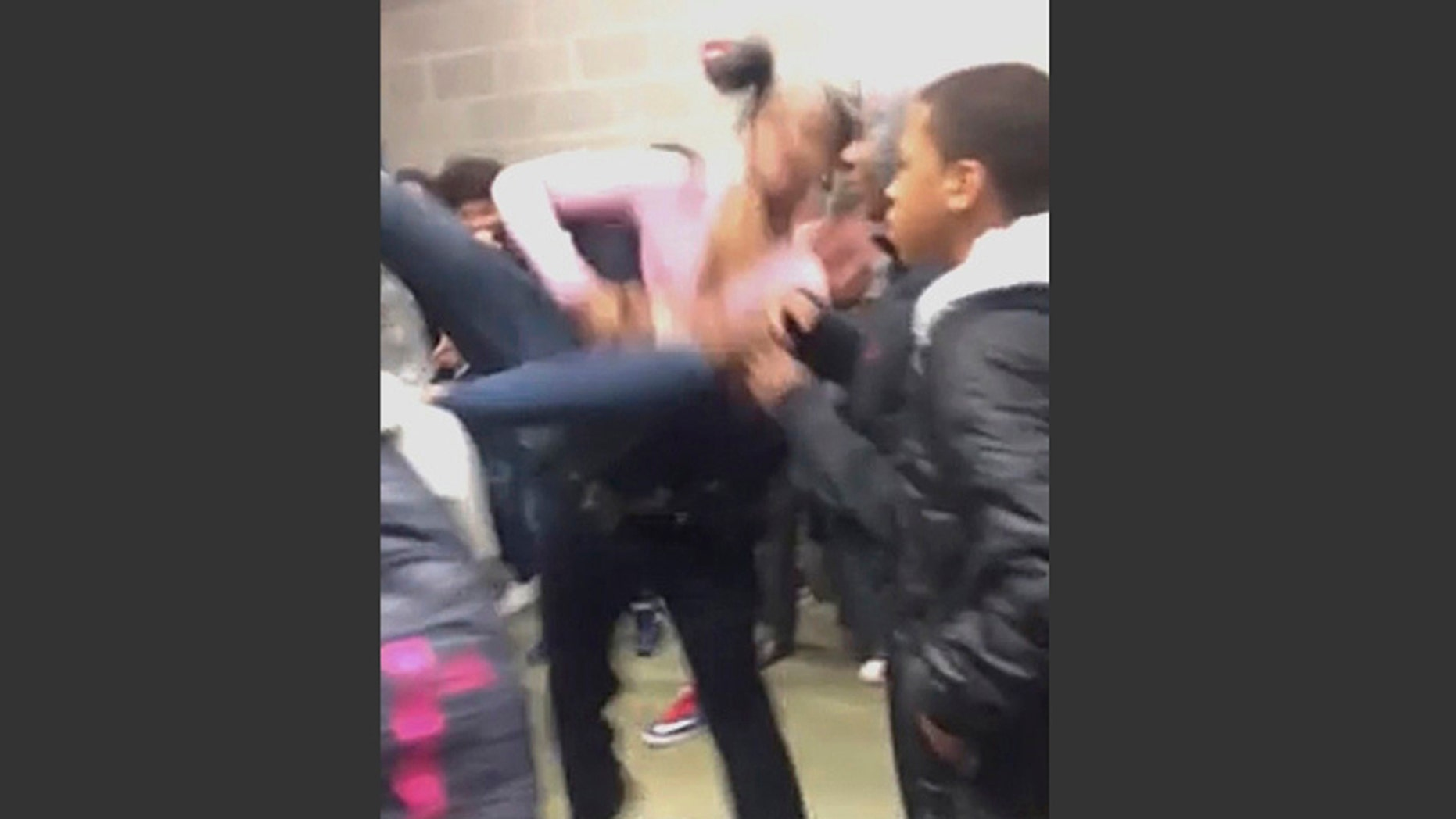 In this Tuesday, Jan. 3, 2017, image made from video and released by Pam C. Akpuda, officer Ruben De Los Santos of the Rolesville Police Department slams a teenage girl to the floor in Rolesville, N.C.