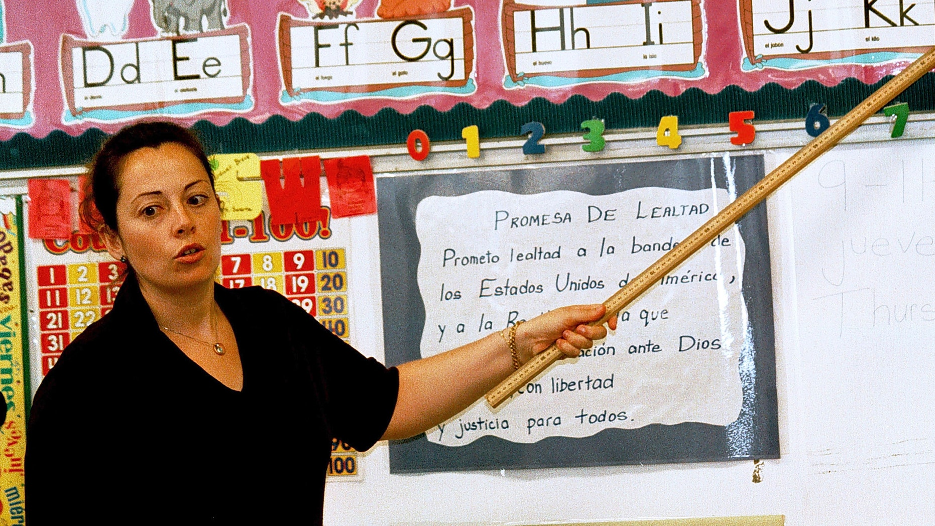 Lourdes Carmona, a Spanish speaking first grade teacher, instructs a class at Birdwell Elementary School in Tyler, Texas.