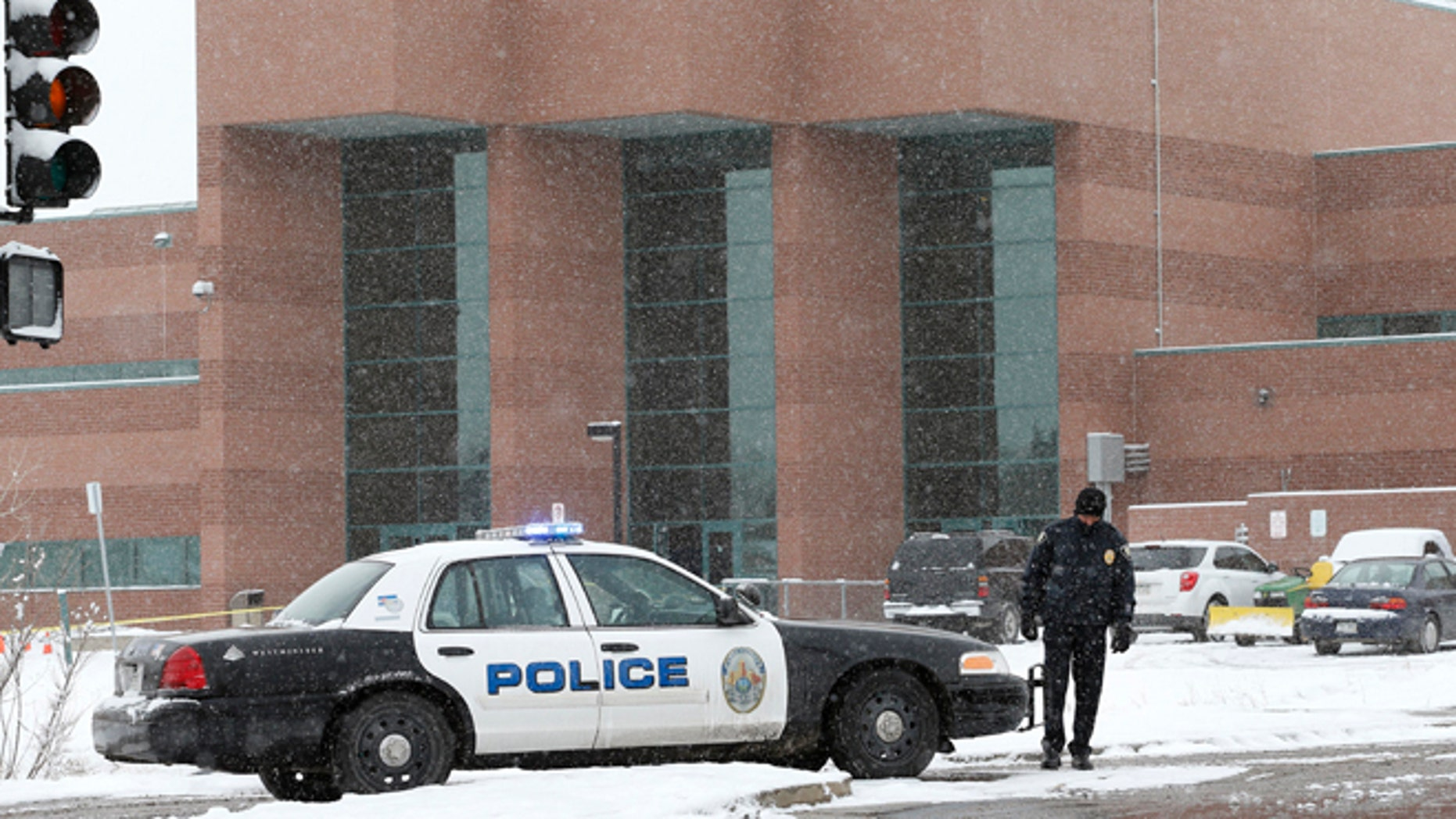Jan. 27, 2014: A police cruiser blocks the entrance to Standley Lake HIgh School, where classes were cancelled after an apparent suicide attempt by a student, in Westminster, Colo.