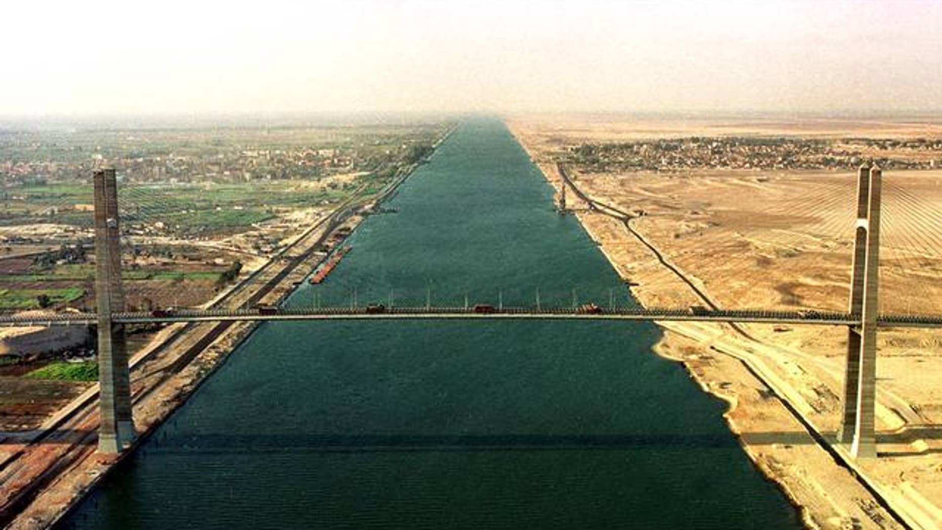 A 2001 file photo of the Suez Canal. Recent anti-presidential protests in Egypt have some concerned over whether or not ship traffic could be disrupted.