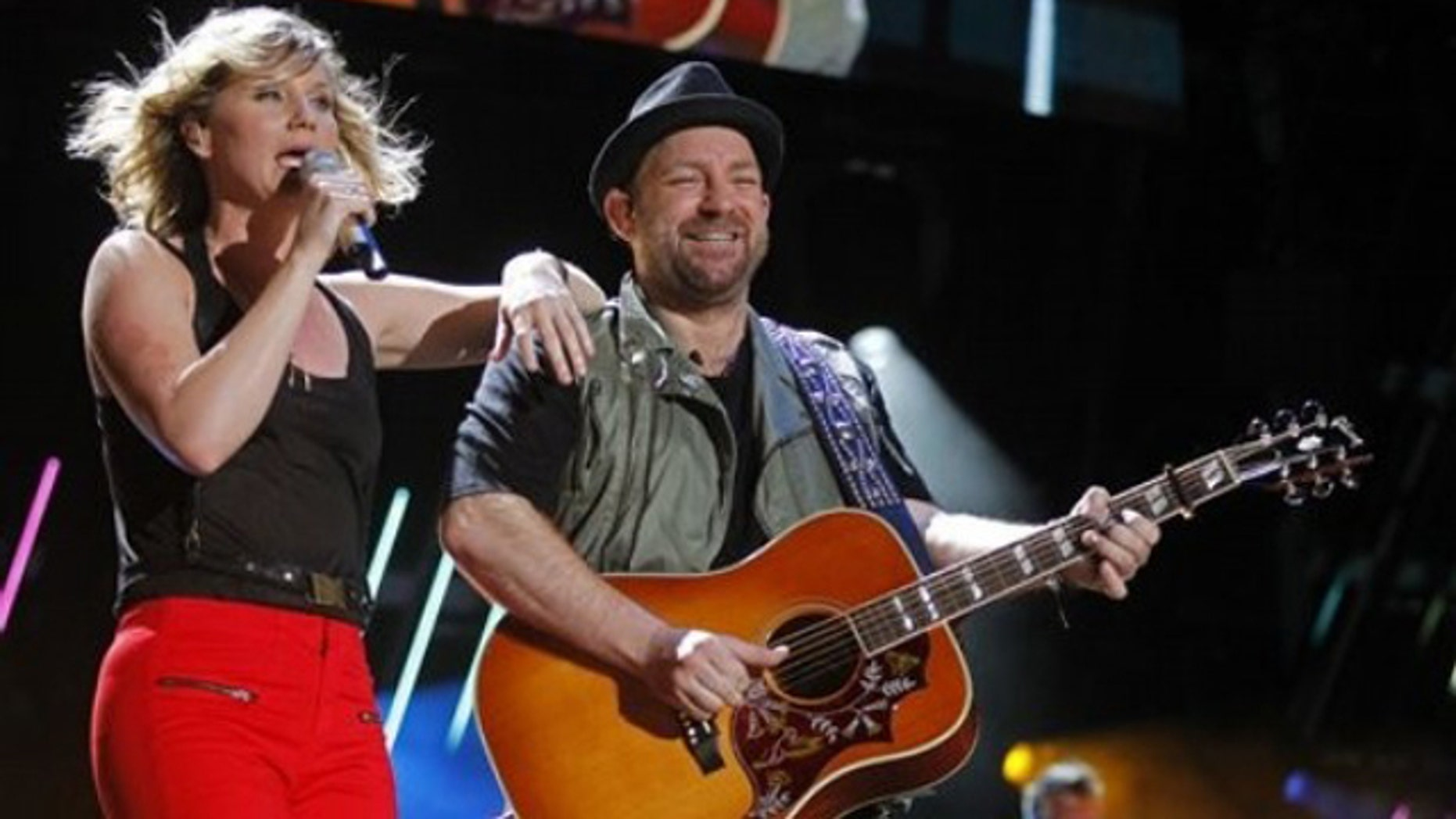Jennifer Nettles, left, and Christian Bush of Sugarland perform during the CMA Fan Festival Friday, June 10, 2011 in Nashville, Tenn. (AP Photo/Wade Payne)