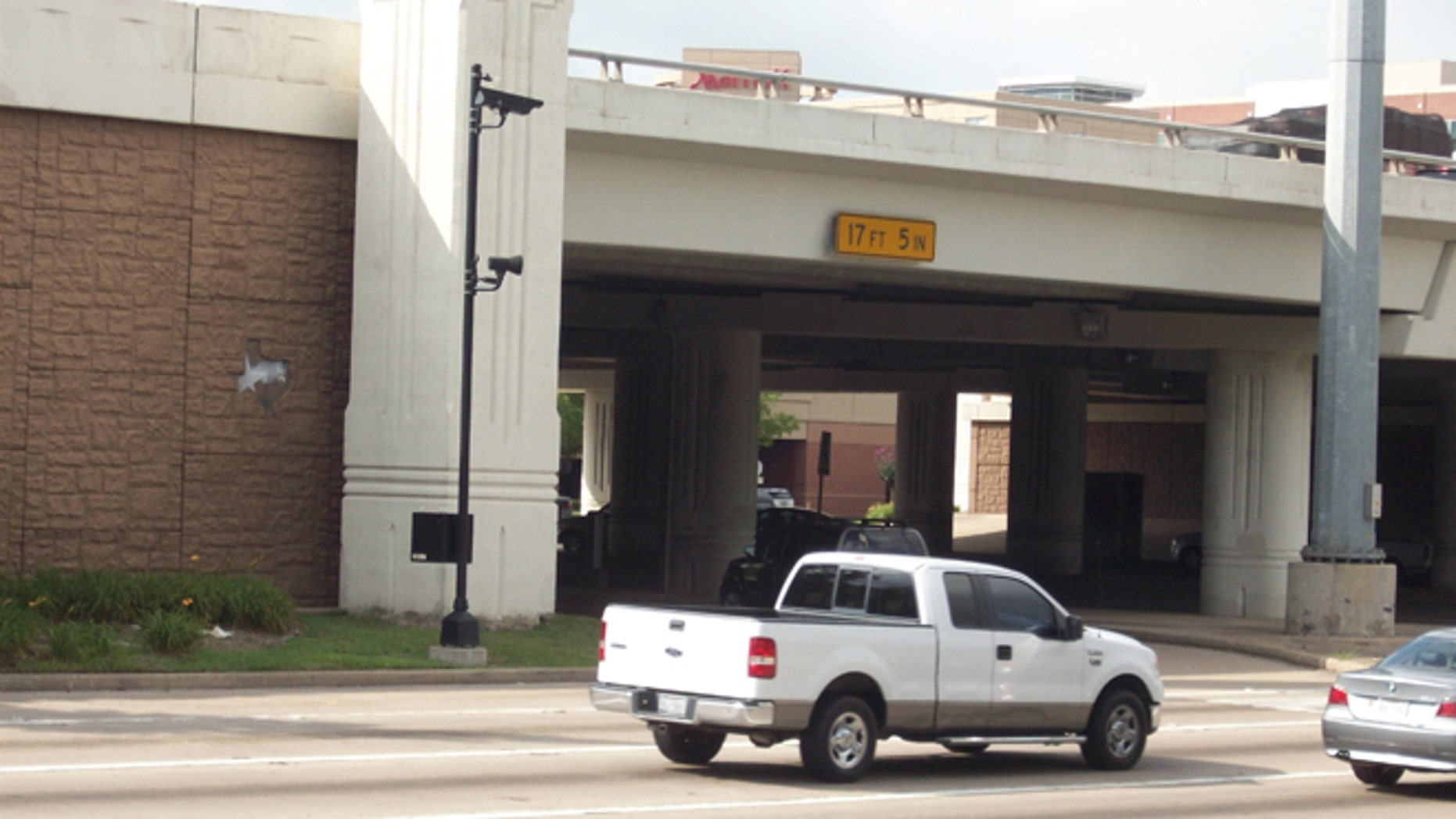 June 12, 2013: Helwig Van Der Grinten, who has never received a red-light ticket from a camera like this one at U.S. Highway 59 at Texas Highway 6, said local lawmakers in Texas are 'turning a deaf ear' to residents of Sugar Land. (Courtesy: Helwig Van Der Grinten)