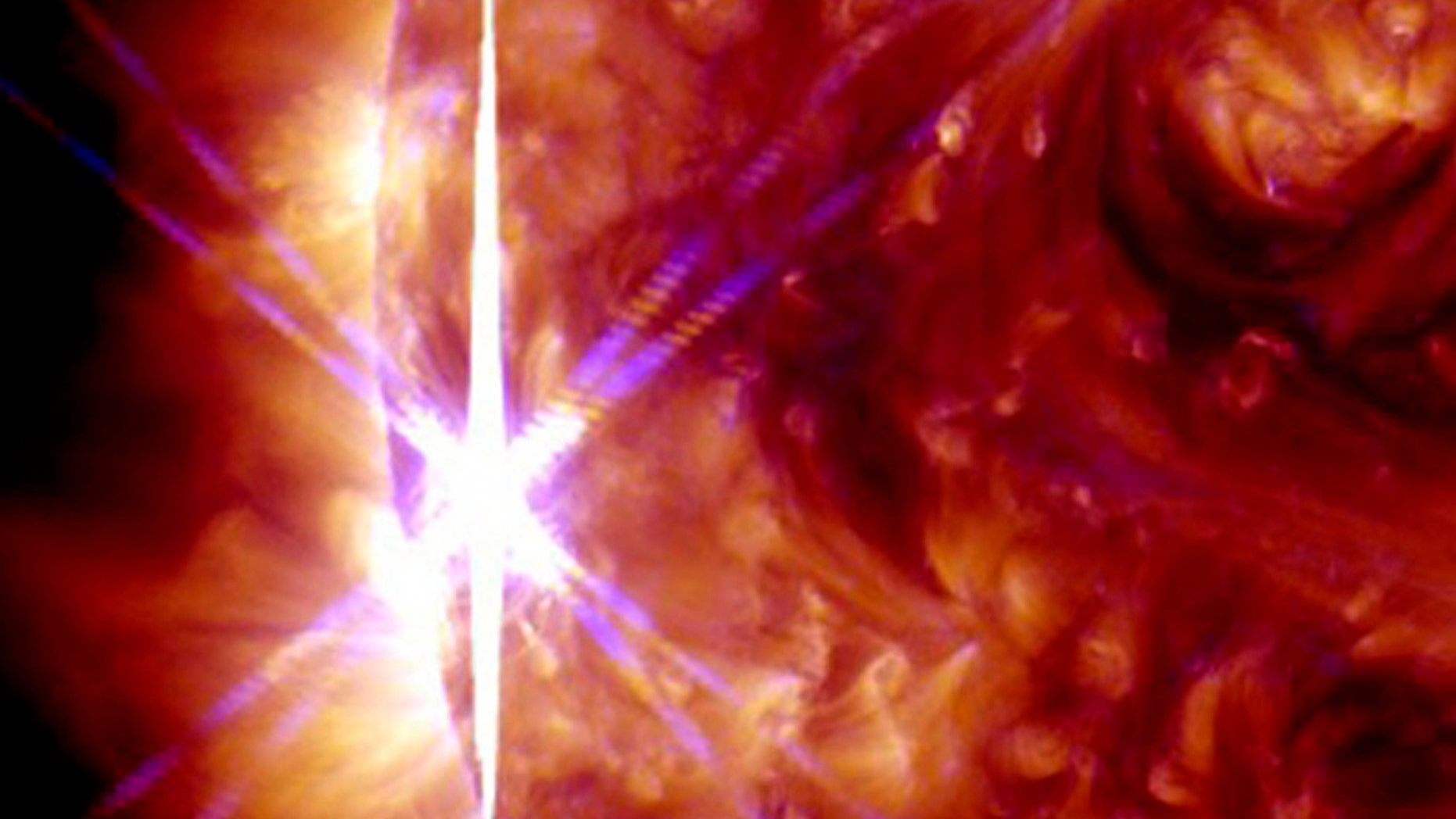 File photo. A solar flare is pictured erupting from the sun October 25, 2013 in this NASA handout photograph from its Solar Dynamics Observatory.