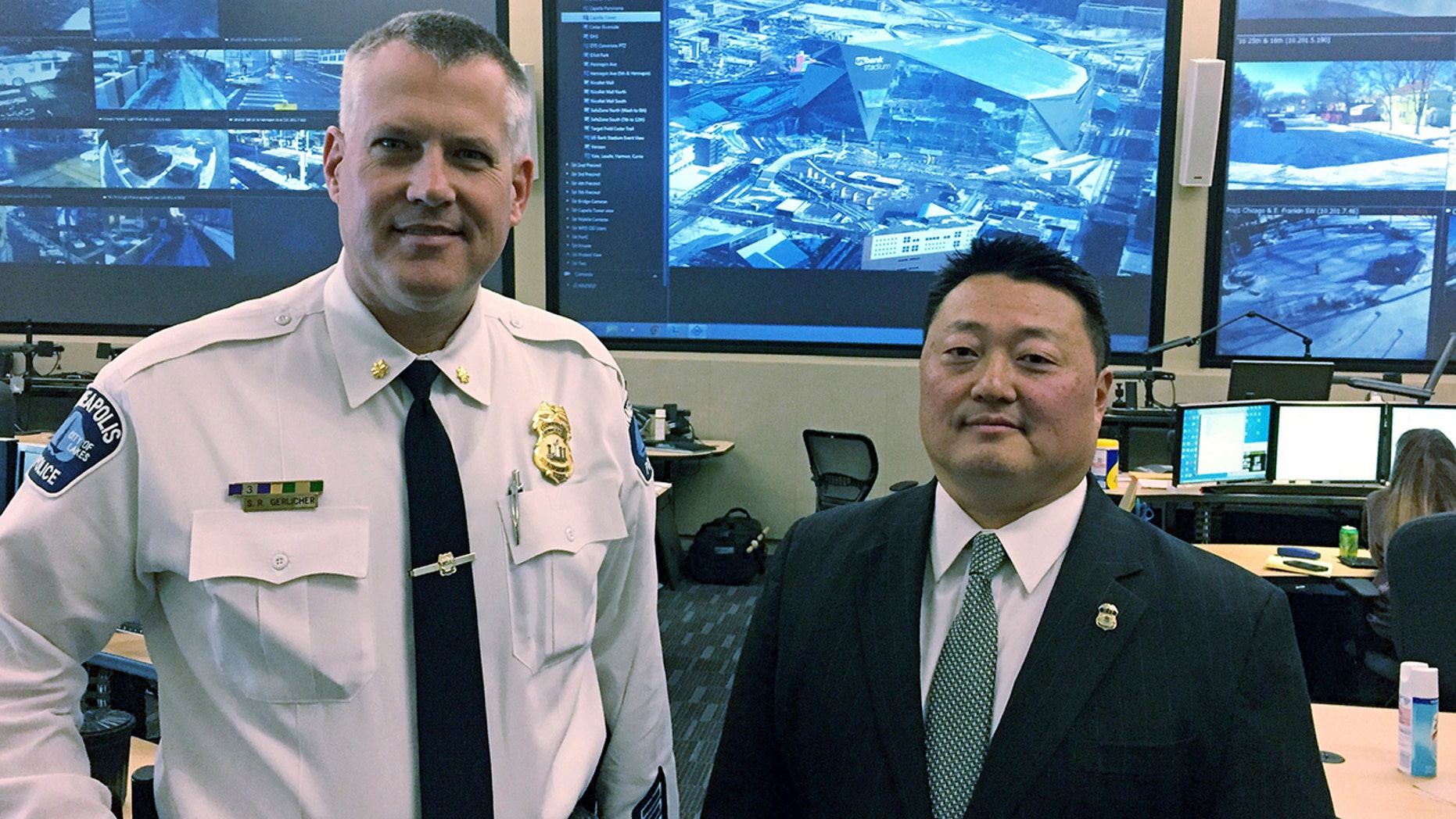 Minneapolis Police Commander Scott Gerlicher, left, and Homeland Security Investigations Special Agent in Charge Alex Khu, right, are heading up security preparations for the Super Bowl in Minnesota.