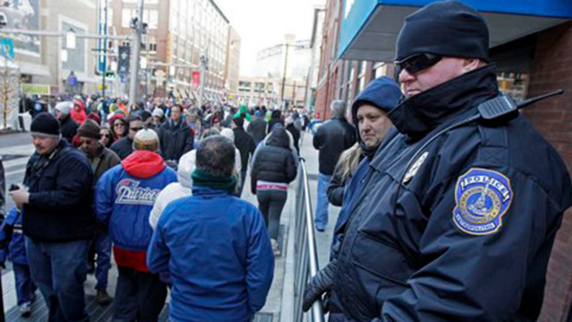 Jan. 29, 2012: Officer David Bryant, right, of the Indianapolis Metropolitan Police, watches the crowd at the Super Bowl Village in Indianapolis.