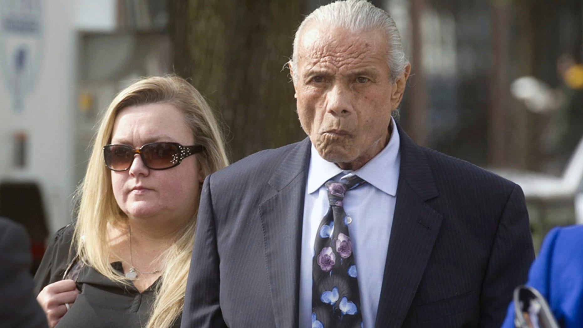 """Nov. 2, 2015:  Former professional wrestler Jimmy """"Superfly"""" Snuka, right, arrives for his formal arraignment at the Lehigh County Courthouse in Allentown, Pa."""
