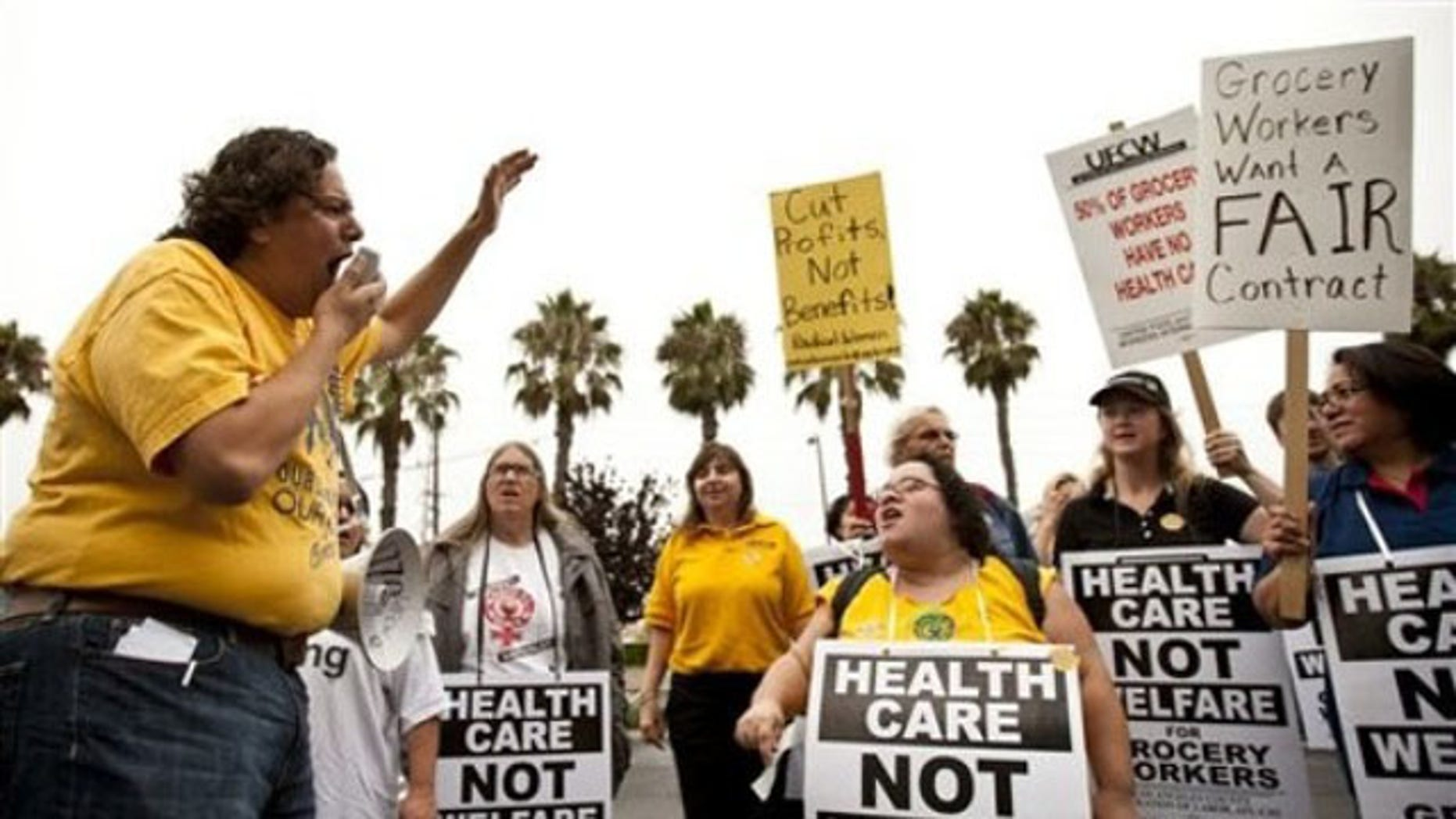 Sept. 16: Local 770 Vice President Rigo Valdez, left, leads a chant during a rally for better health care and benefits for grocery store workers at the Ralphs grocery store in Marina Del Ray, Calif.