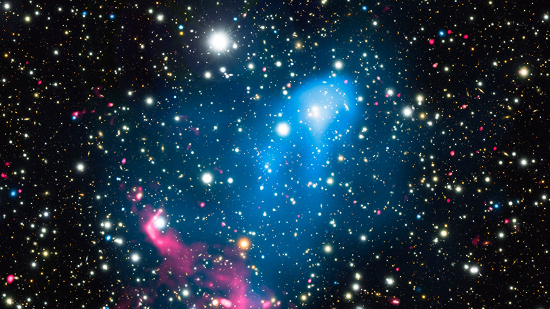 Particles ejected from a supermassive black hole are caught up in a galaxy merger, blasting the material even more powerfully into space. ( X-ray: NASA/CXC/SAO/R. van Weeren et al.; Optical: NAOJ/Subaru; Radio: NCRA/TIFR/GMRT)