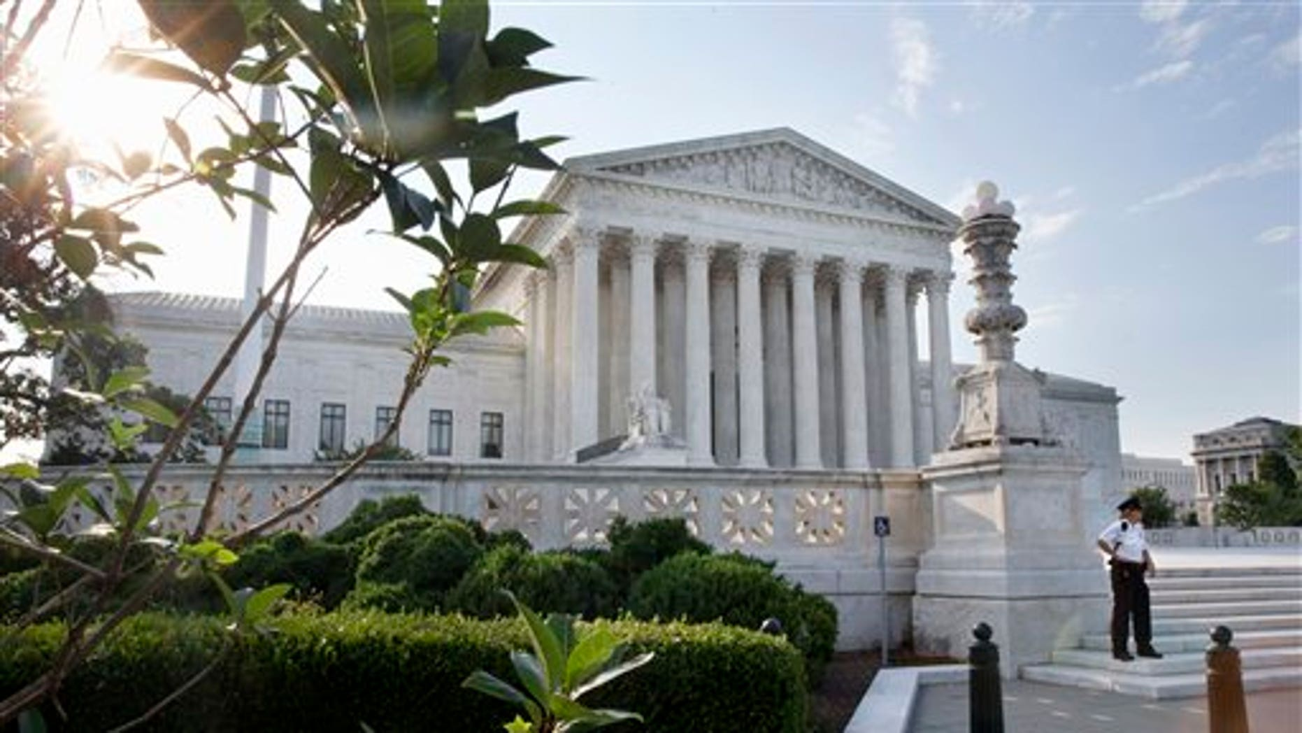 FILE -- June 25, 2015: Security guard in front of the Supreme Court in Washington. (AP Photo/Jacquelyn Martin)