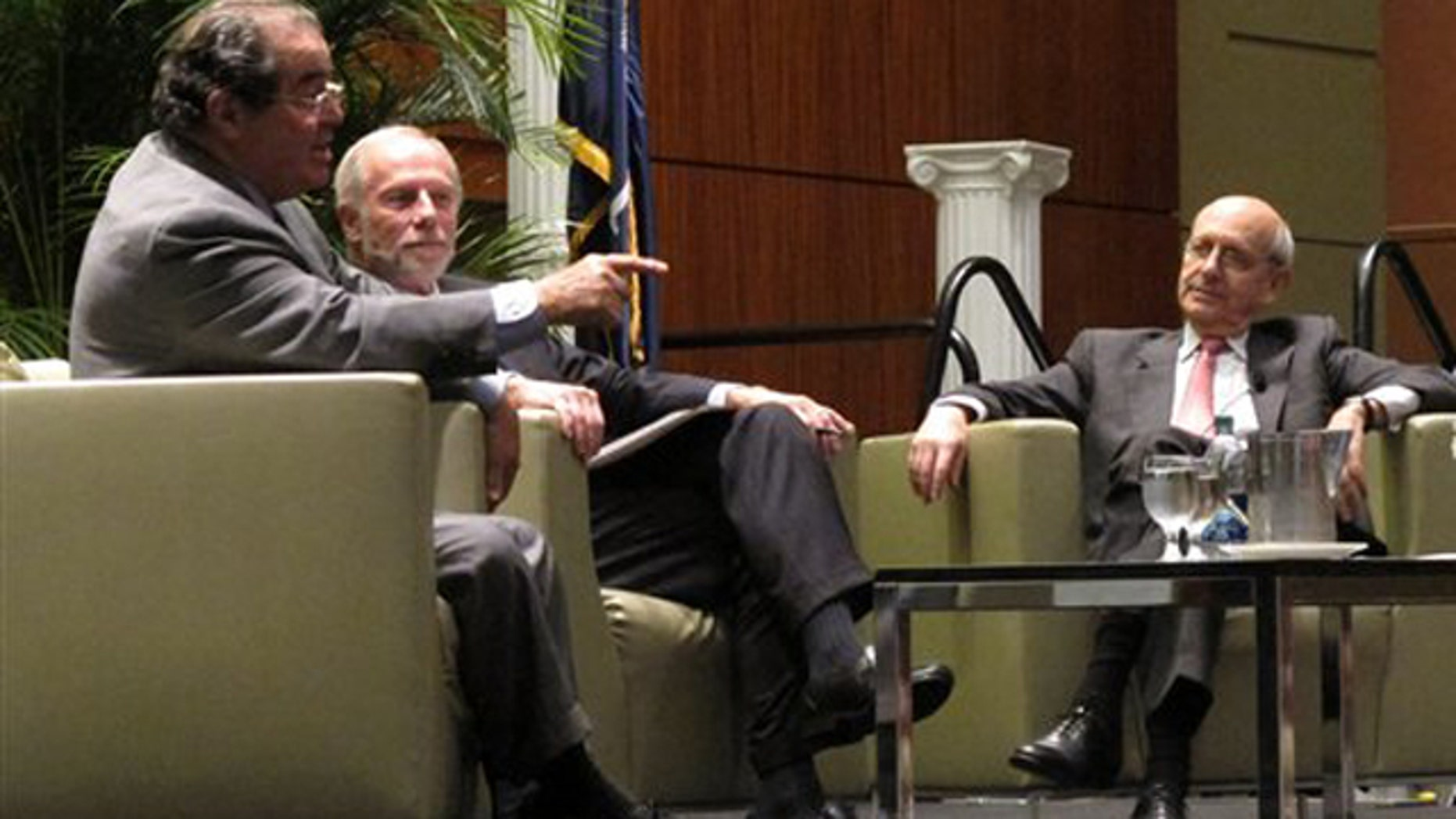 Jan. 21, 2012: U.S. Supreme Court Justices Antonin Scalia, left, and Stephen Breyer, right, talk to moderator Charles Bierbauer, center, at a debate before the South Carolina Bar in Columbia, S.C.