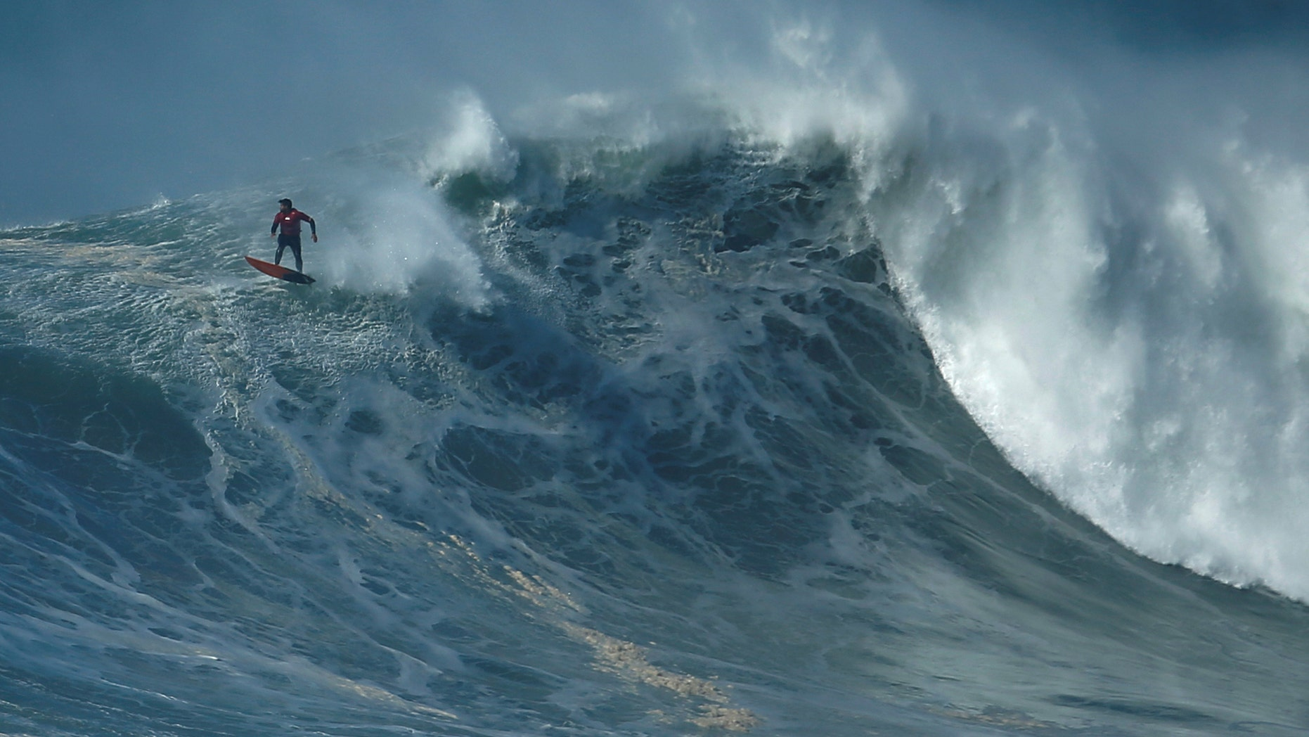 File photo: A surfer drops in on a large wave at Praia do Norte in Nazare, Portugal, February 10, 2017.  (REUTERS/Rafael Marchante )