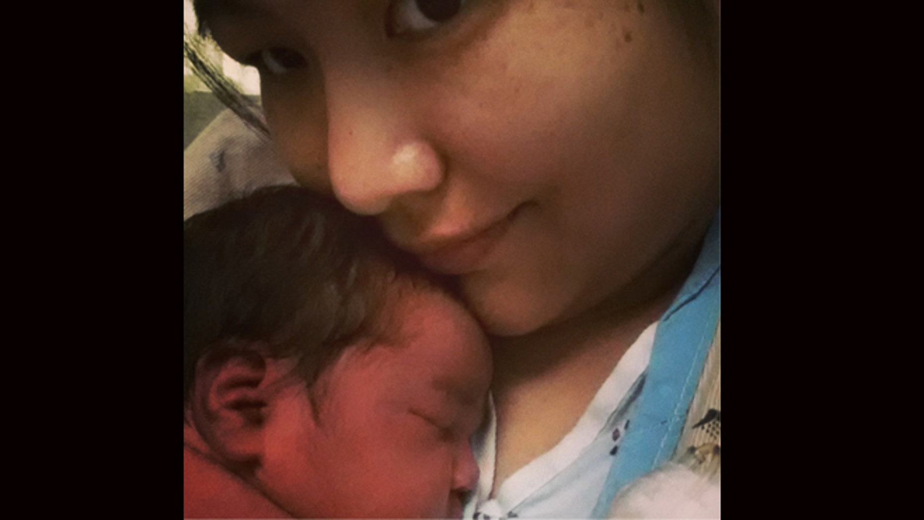 This undated cell phone picture provided by Trish Staine shows Staine, right, with her newborn baby, in Duluth, Minn. Staine, a 33-year-old aspiring half-marathon runner, says she had no idea she was pregnant before giving birth Monday, June 5, 2013. (AP Photo/Patricia Staine)