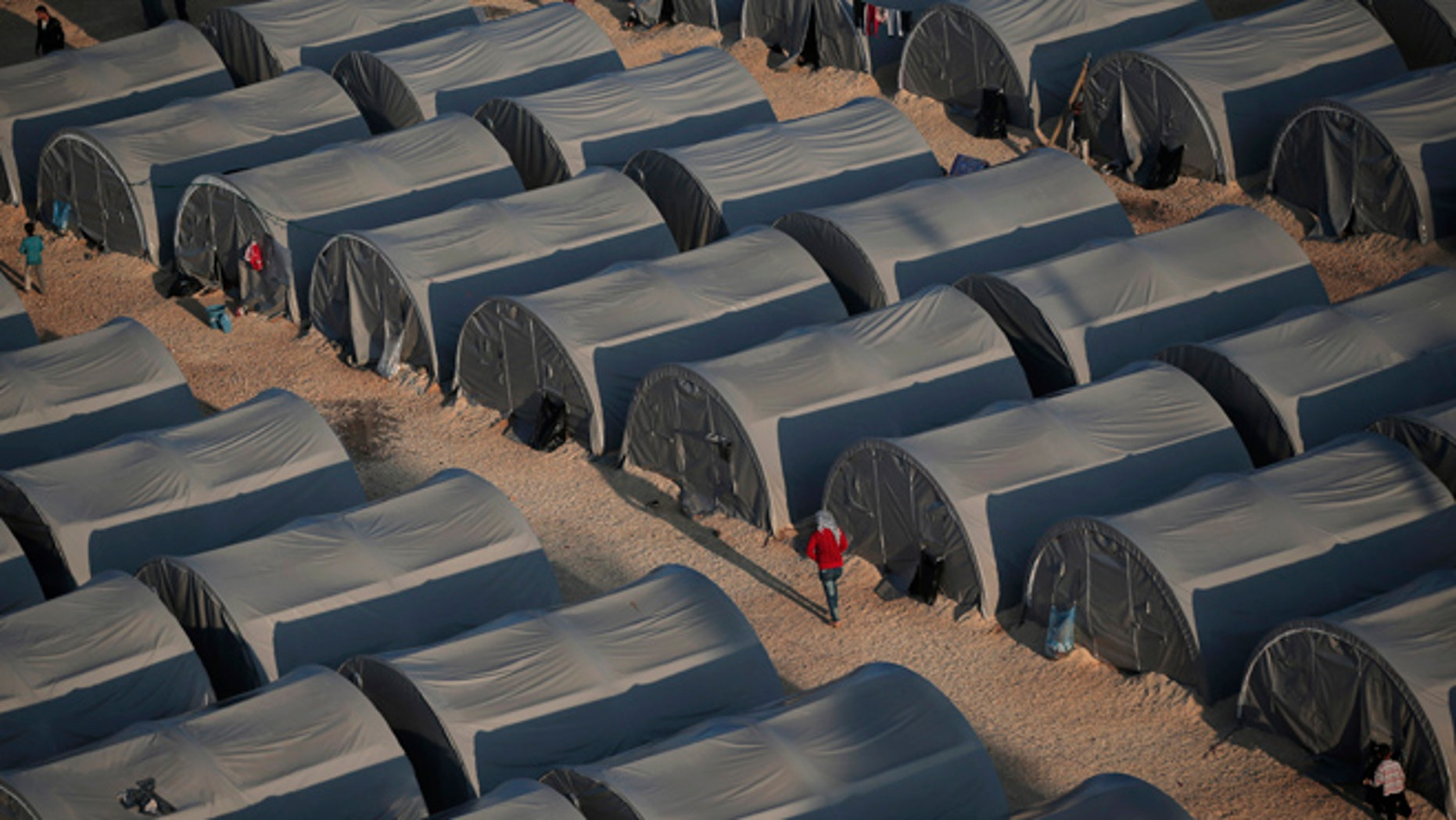 In this Oct, 17, 2014, file photo, Syrian Kurdish refugees are seen at a refugee camp in Suruc, on the Turkey-Syria border.