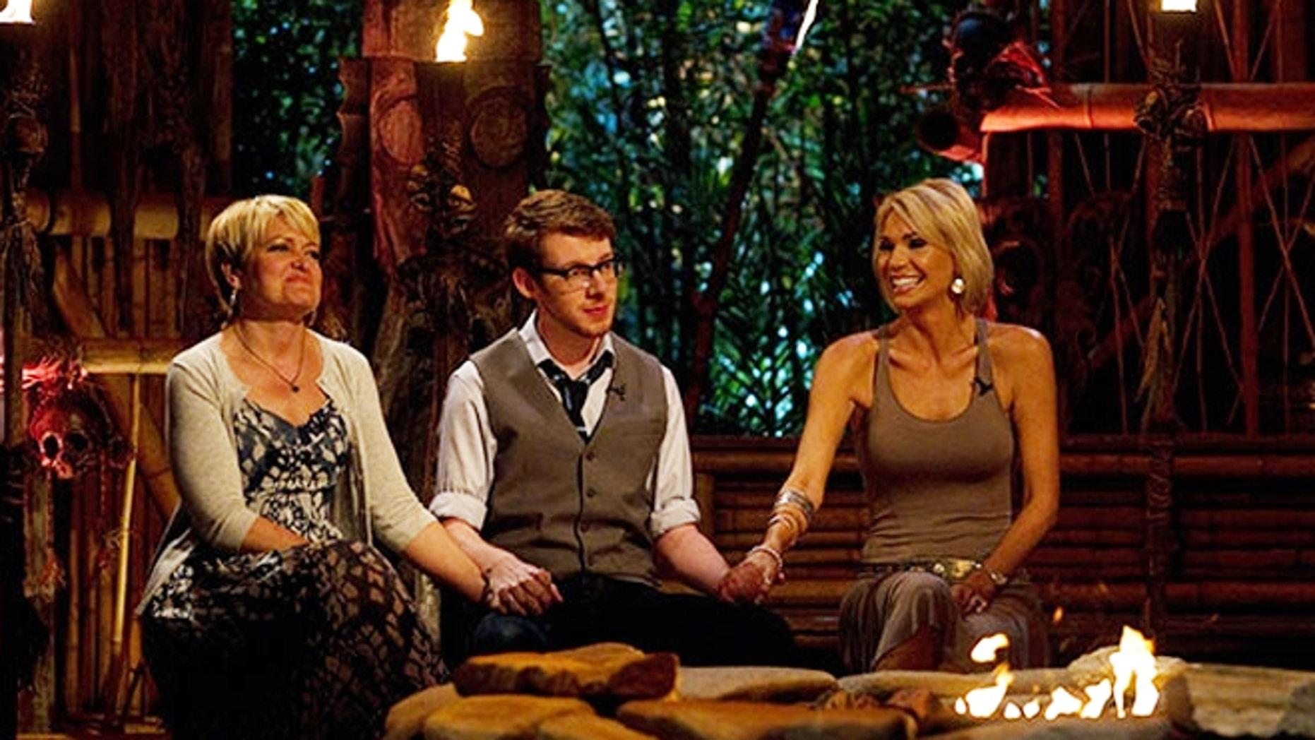 "The final three contestants await the announcement of the winner on ""Survivor."""