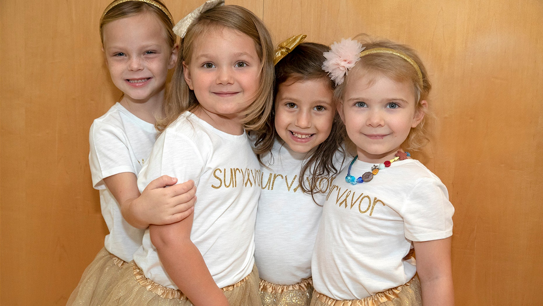The four friends, who first met in 2016 while undergoing treatment, reunited for the touching photo during Childhood Cancer Awareness month.