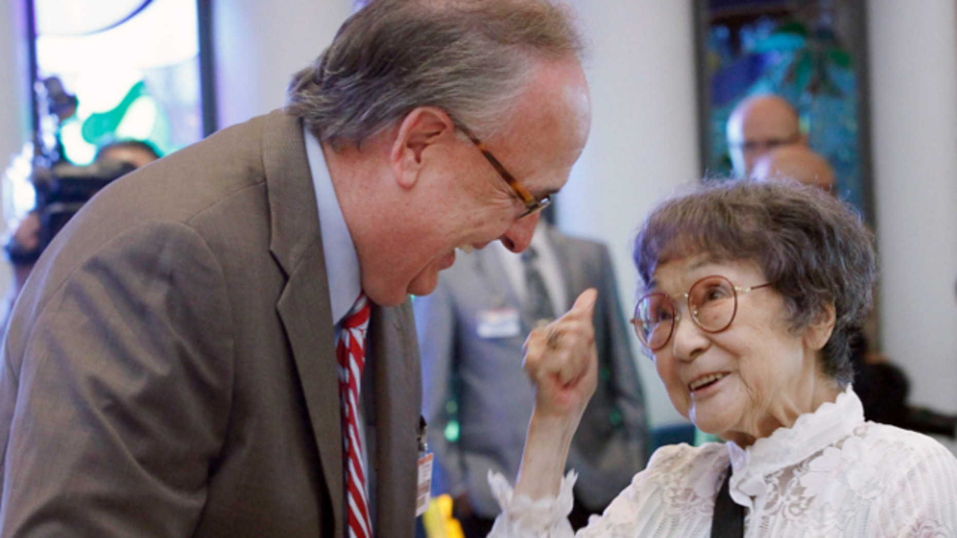 June 28, 2013: Survivor of atomic blast in Hiroshima, Kaz Sueishi, right, President of the American Society of Hiroshima-Nagasaki A-bomb Survivors, is greeted by Michael Hunn, Senior Vice President/ Chief Executive of Providence Health & Services, during a press conference in Torrance, Calif.