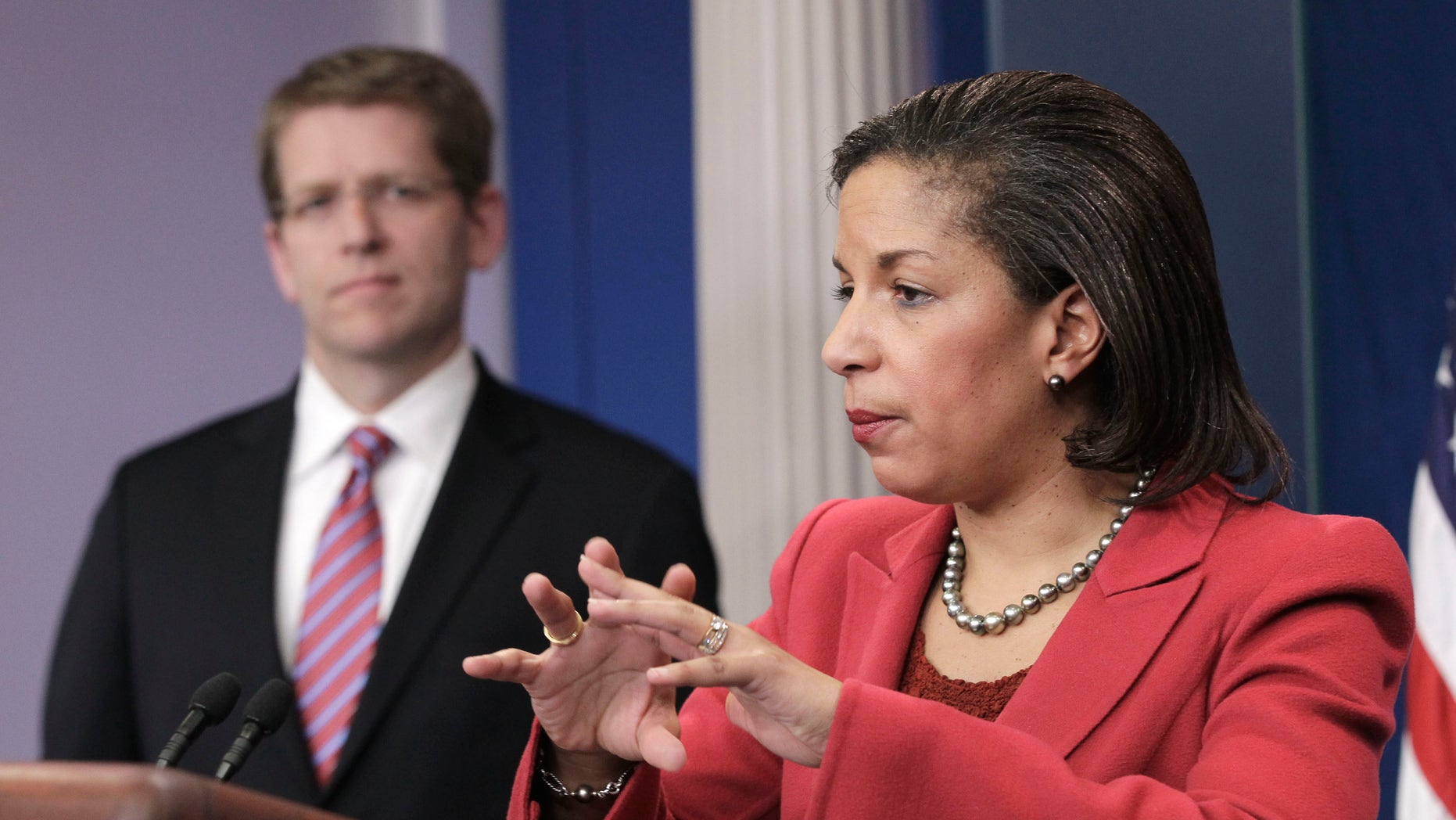 US Ambassador to the United Nations Susan Rice, right, accompanied by White House Press Secretary Jay Carney, gestures during the daily news briefing at the White House in Washington, Monday, Feb., 28, 2011. (AP)