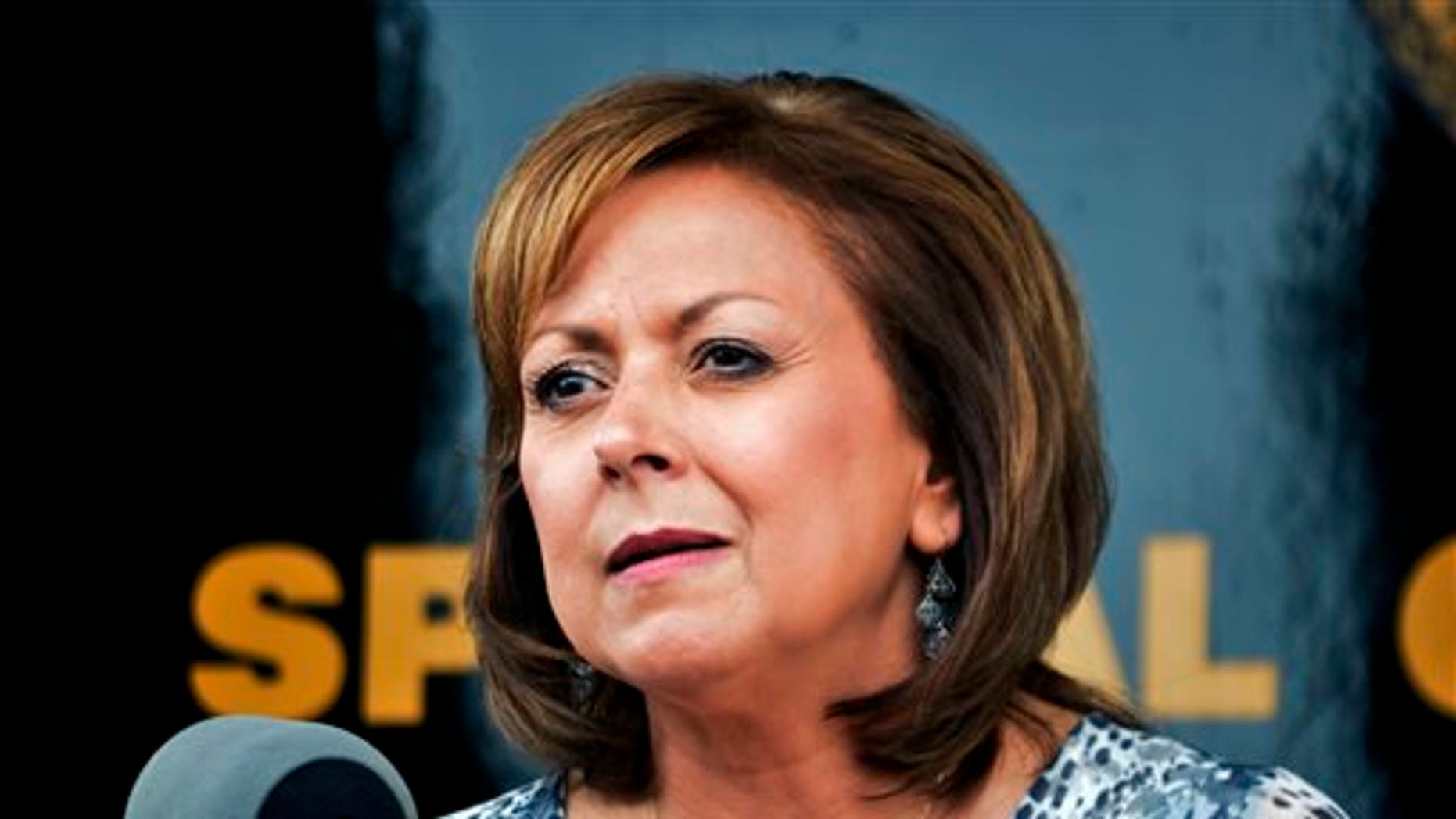 FILE - In this Sept. 4, 2015 file photo, New Mexico Gov. Susana Martinez speaks at a news conference in Albuquerque. Martinez finally got lawmakers to pass her long-sought revision of a state law that grants drivers licenses to immigrants in the country illegally. (AP Photo/Russell Contreras, File)