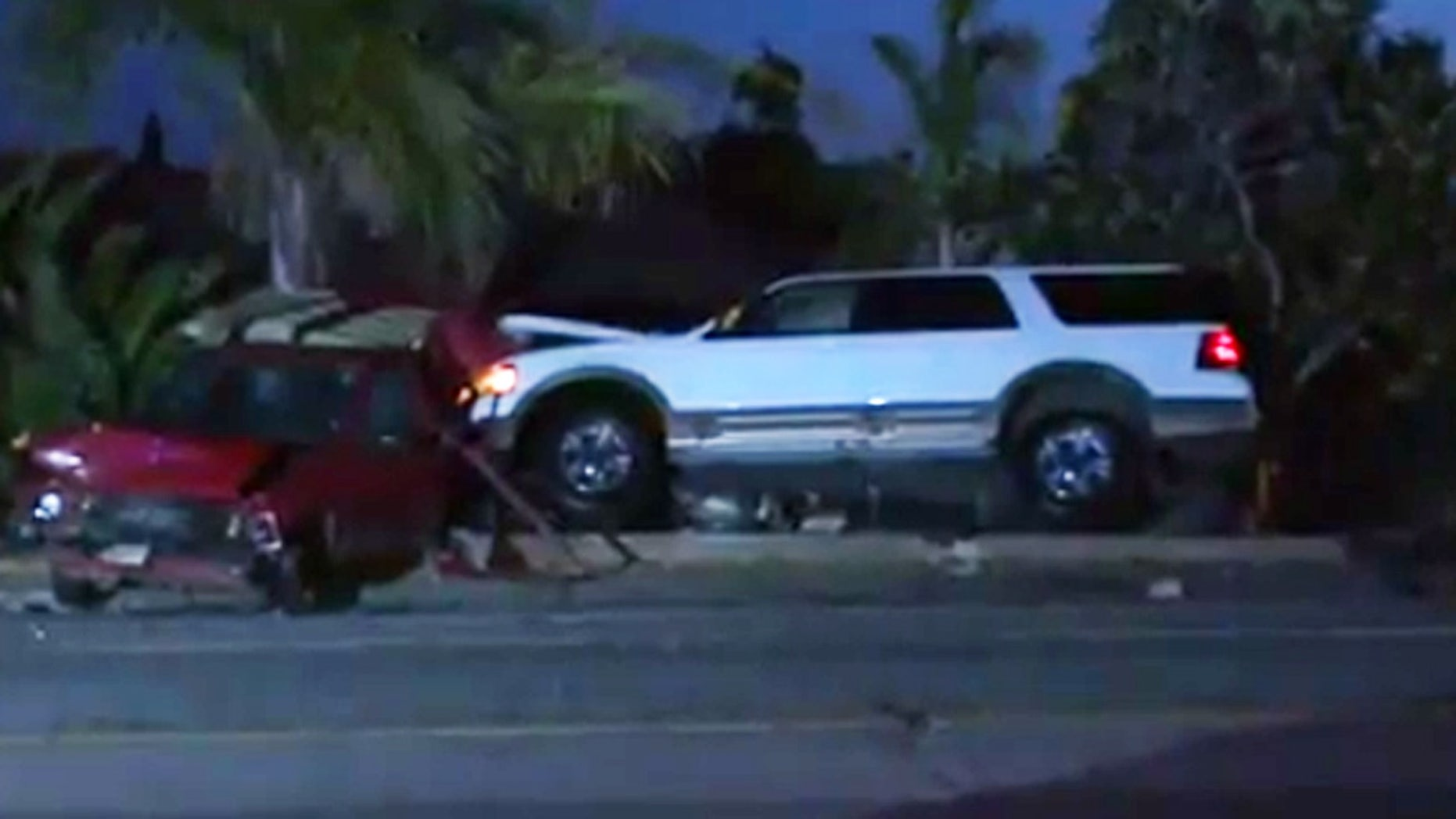 A Fox 5 photographer rescued a man who crashed into a parked vehicle with his SUV.