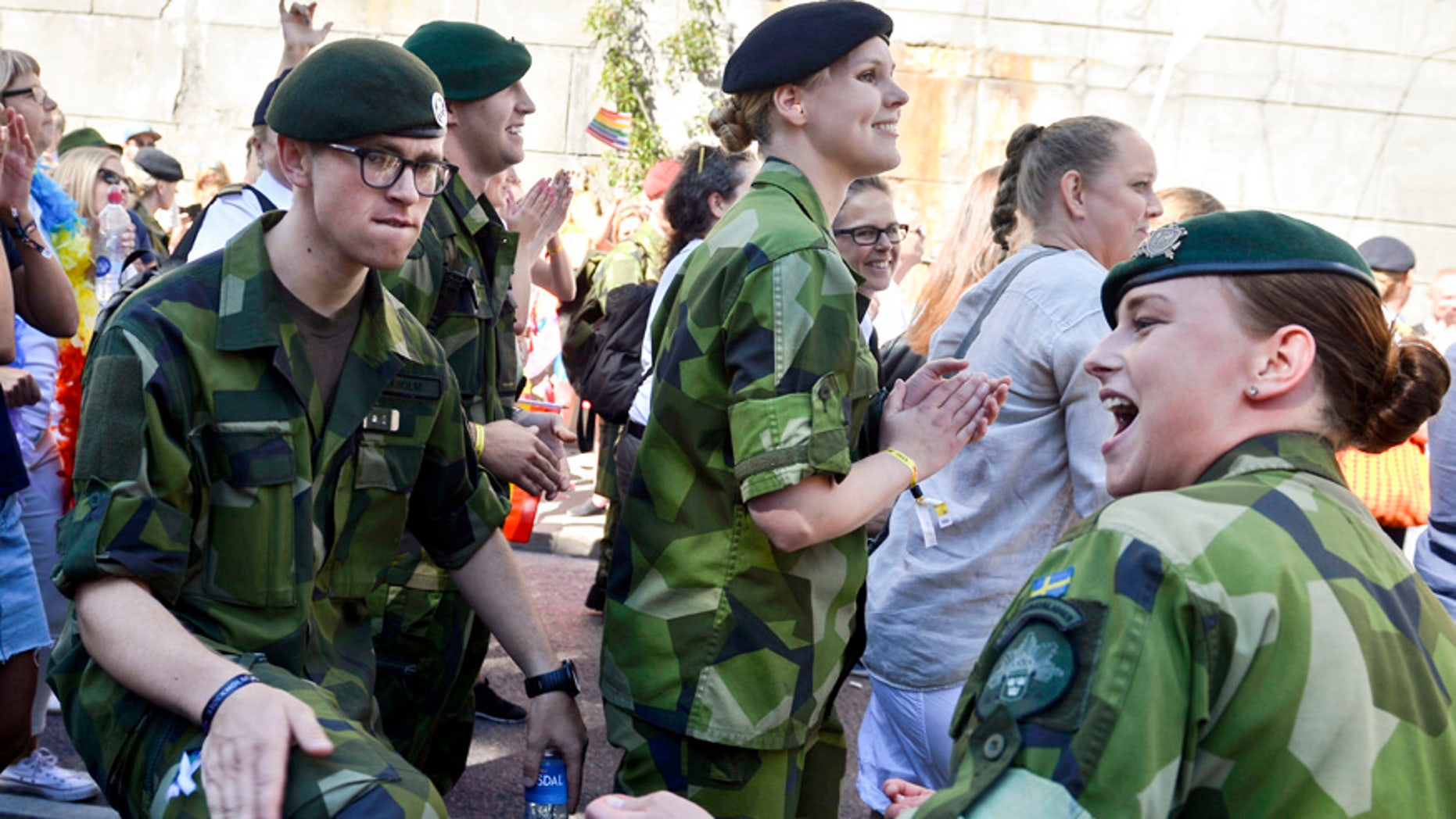 FILE - This is a Saturday Aug. 1, 2015  file photo of Swedish Army personnel as they take part in the annual gay Pride Parade in Stockholm.  Sweden's left-leaning government is reintroducing a military draft for both men and women because of what Defense Minister Peter Hultqvist calls a deteriorating security environment in Europe and around Sweden. T ?(Vilhelm Stokstad/TT , File via AP)