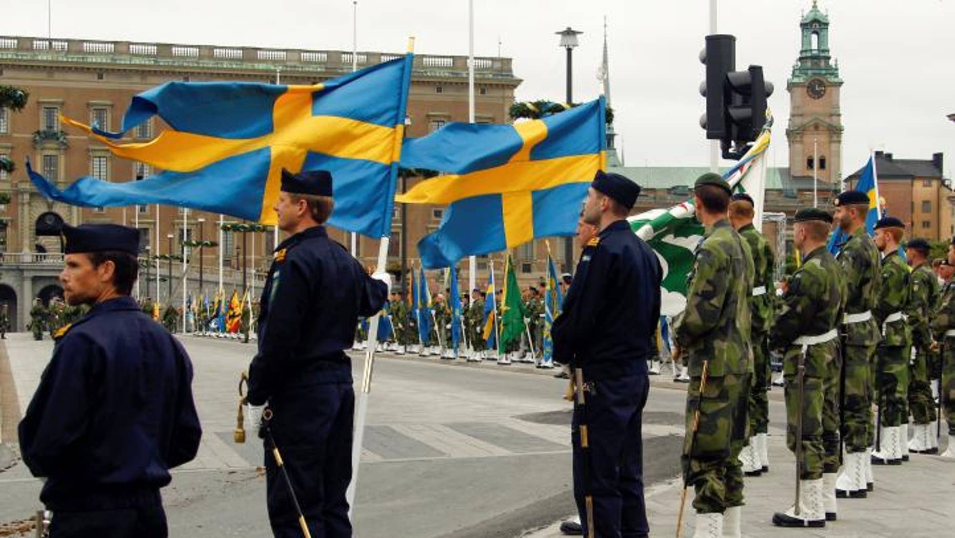 FILE -- June 18, 2010: Swedish armed forces soldiers attend a rehearsal in front of the Royal Palace in Stockholm, Sweden.