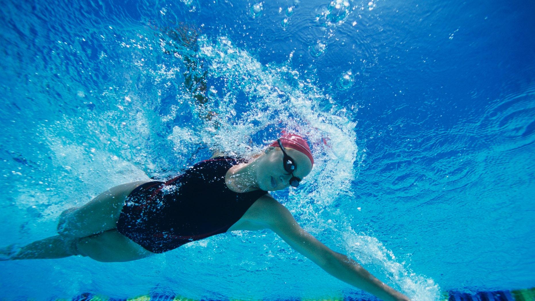 Female Swimmer Swimming Mid-stroke