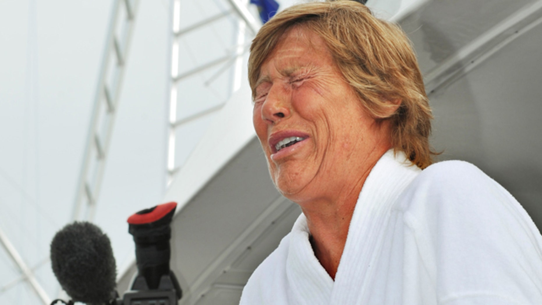 Aug. 9: Diana Nyad cries as she speaks to reporters and fans after arriving back in Key West.