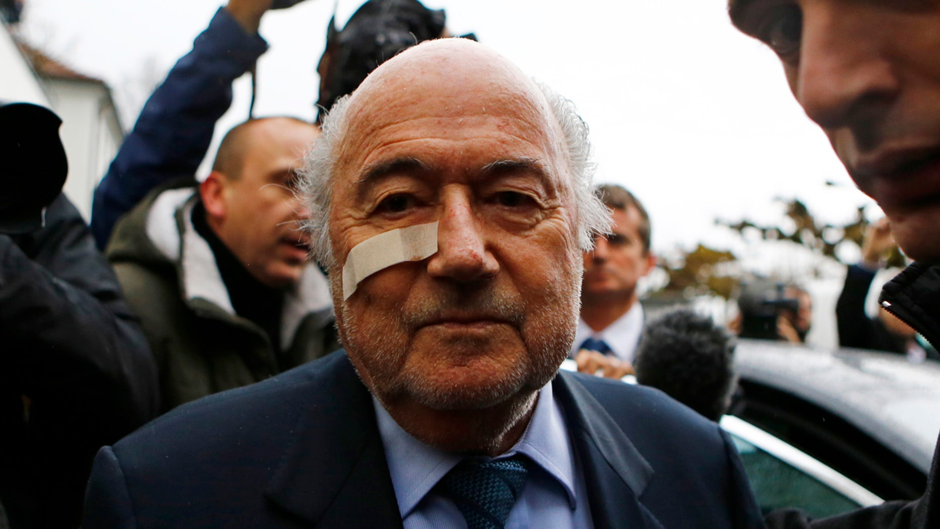 Suspended FIFA President Sepp Blatter arrives for a news conference in Zurich, Switzerland,  Monday, Dec. 21, 2015 after he has been banned for 8 years from all football related activities. (AP Photo/Matthias Schrader)