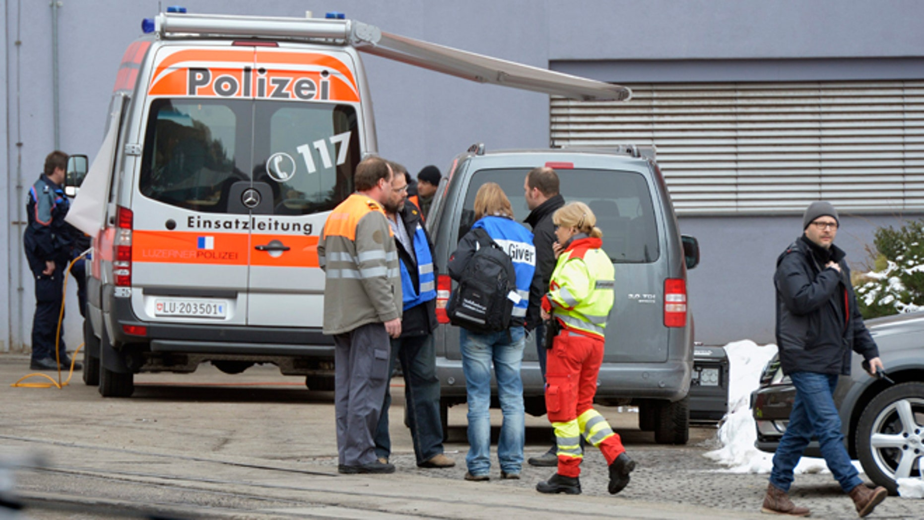 Feb. 27, 2013: Police stand in front of a wood-processing company in Menznau, central Switzerland, where several people were killed in a shooting. Police in Lucerne canton (state) said in a statement that the shooting occurred shortly after 9 a.m. at the premises of Kronospan, a company in the small town west of Lucerne. They said there were several dead and several seriously injured people and that rescue services were deployed and the scene sealed off.