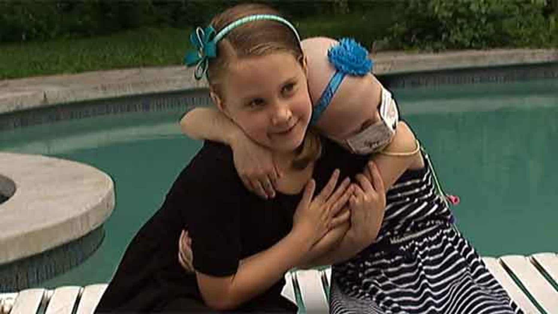 Hayden, left, was found to be a perfect match to donate bone marrow to her sister Sydney, right.