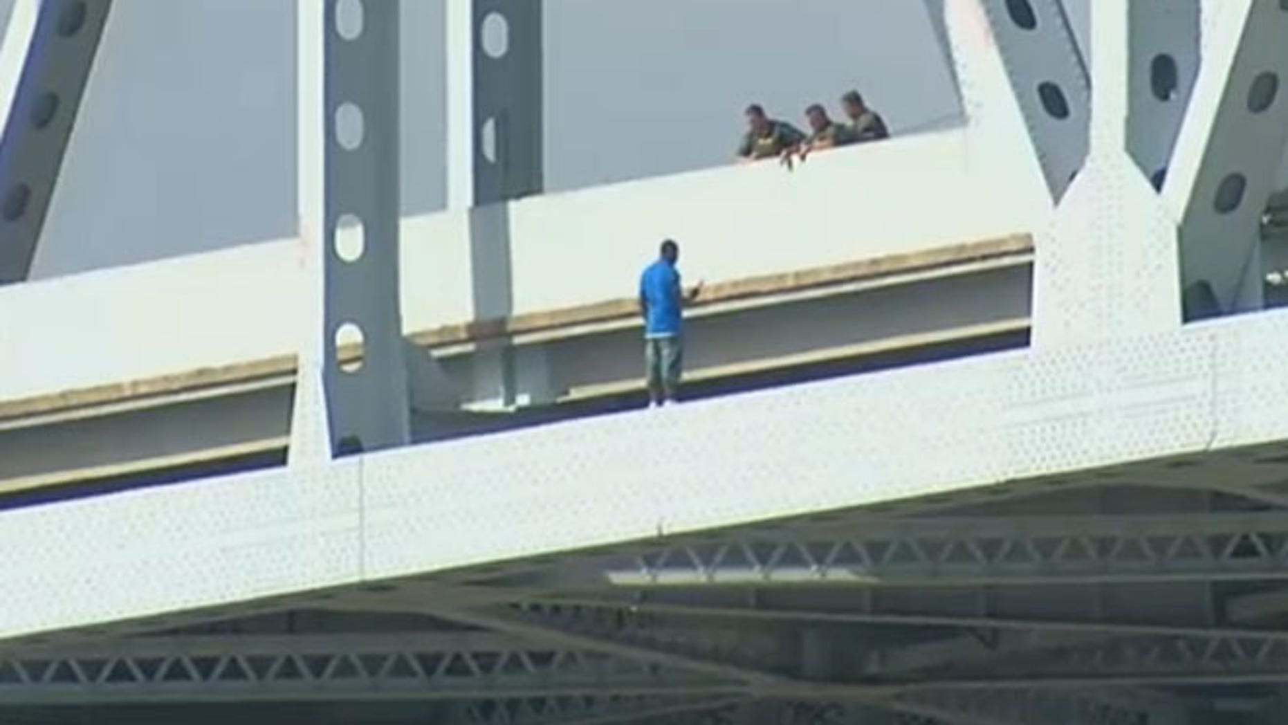 A man on the bridge was threatening to jump off.