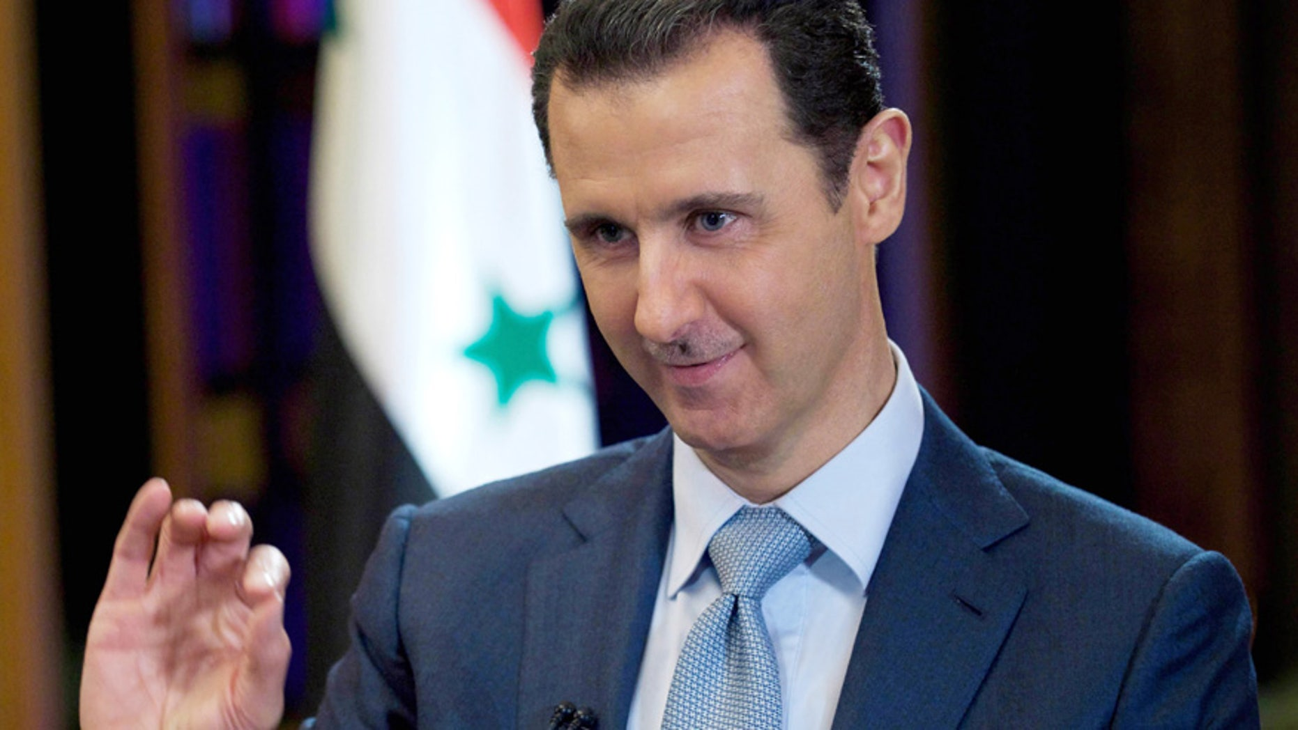 In this Feb. 10, 2015, file photo released by the Syrian official news agency SANA, Syrian President Bashar Assad gives an interview with the BBC in Damascus, Syria