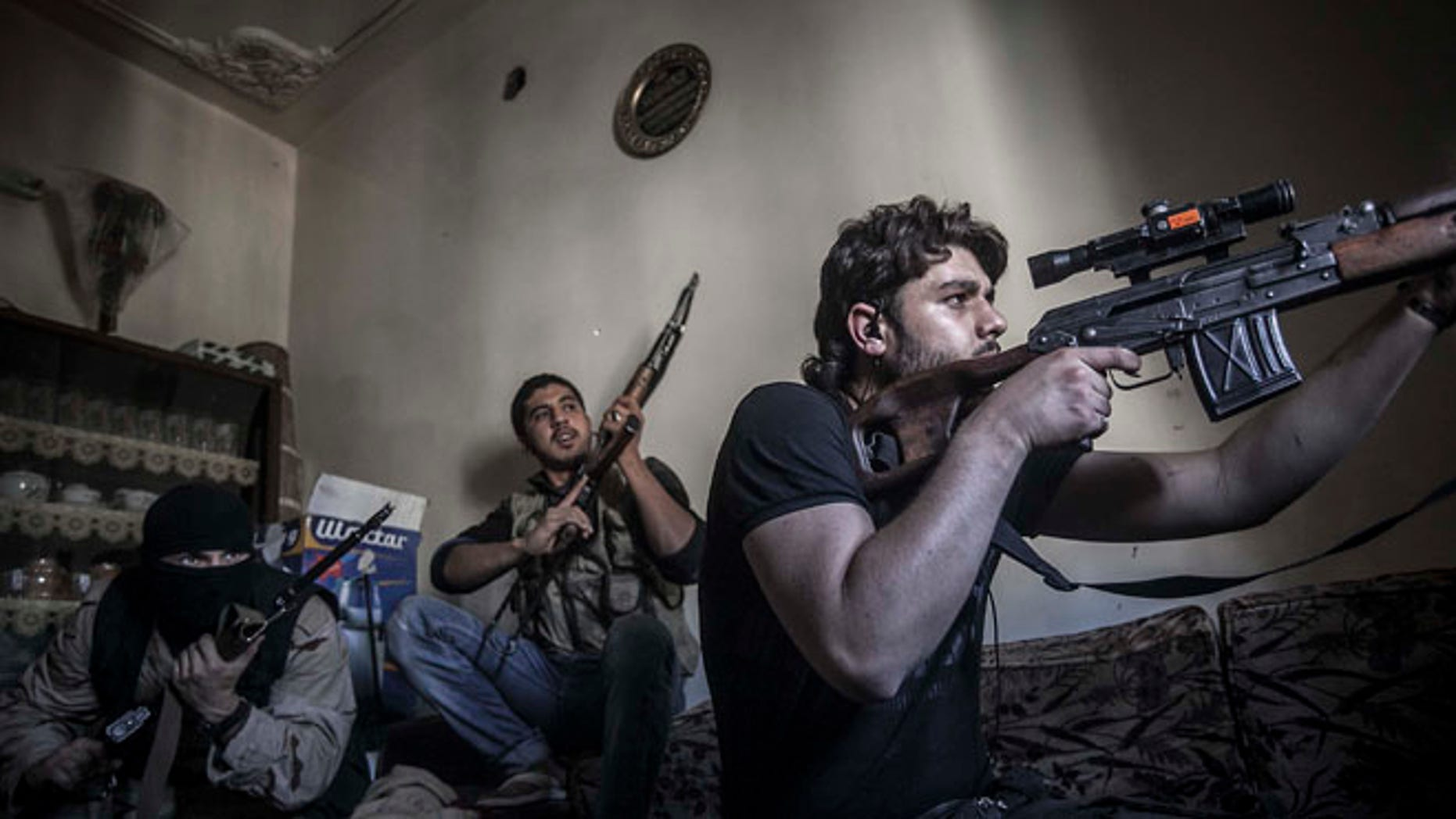 Oct. 29, 2012: In this photo, a rebel sniper aims at Syrian army positions in the Aleppo Jedida district, Syria.