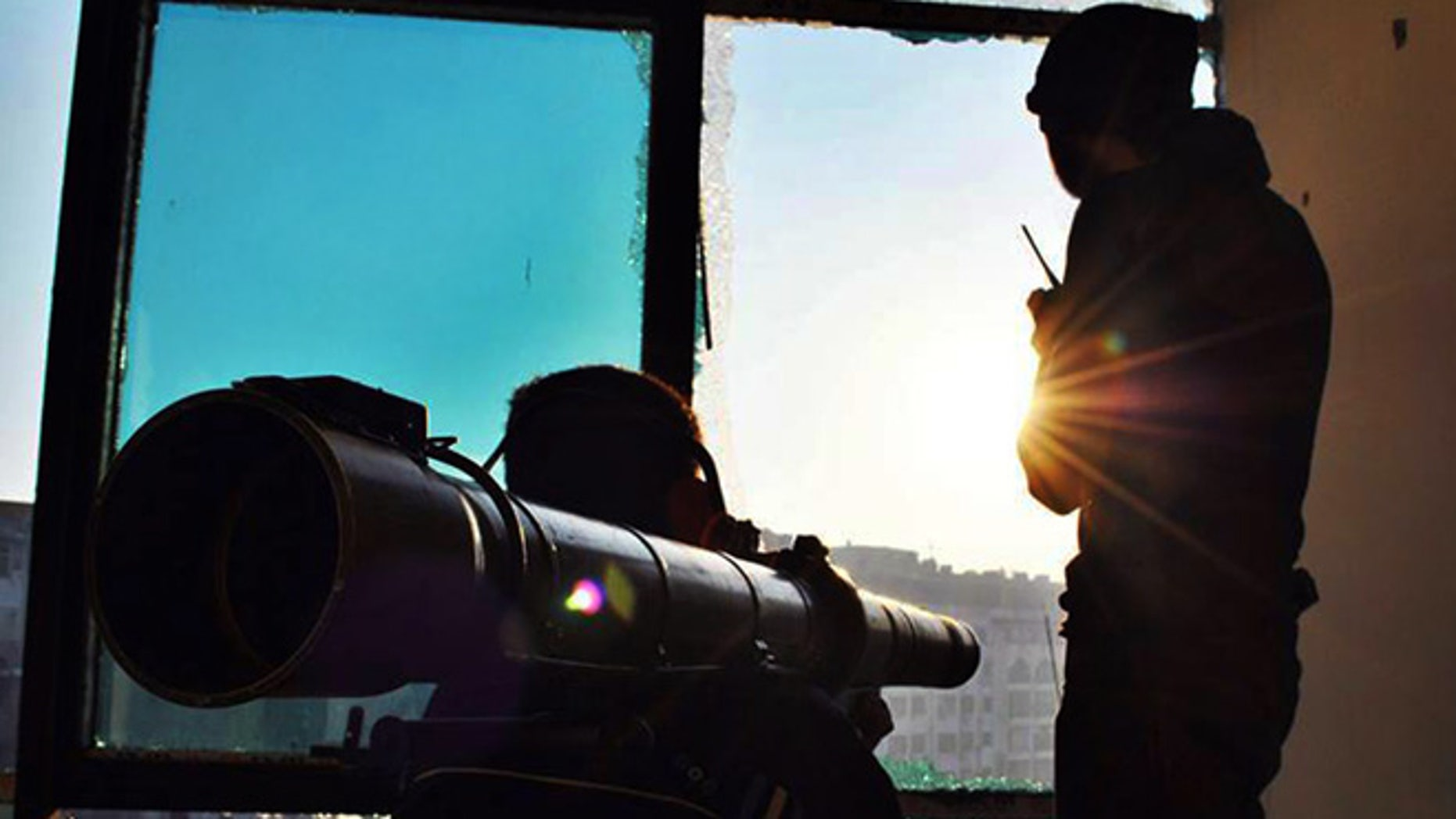June 18, 2013: This citizen journalism image provided by Lens Young Homsi, which has been authenticated based on its contents and other AP reporting, shows Syrian rebels using a rocket launcher to attack Syrian soldiers loyal to Syrian president Bashar Assad, in Homs province, Syria. Syrian warplanes bombed rebel positions near a contested military air base in the north of Syria on Tuesday, activists said, while President Bashar Assad's forces nearby pressed ahead with an offensive against opposition fighters in the country's largest city Aleppo.
