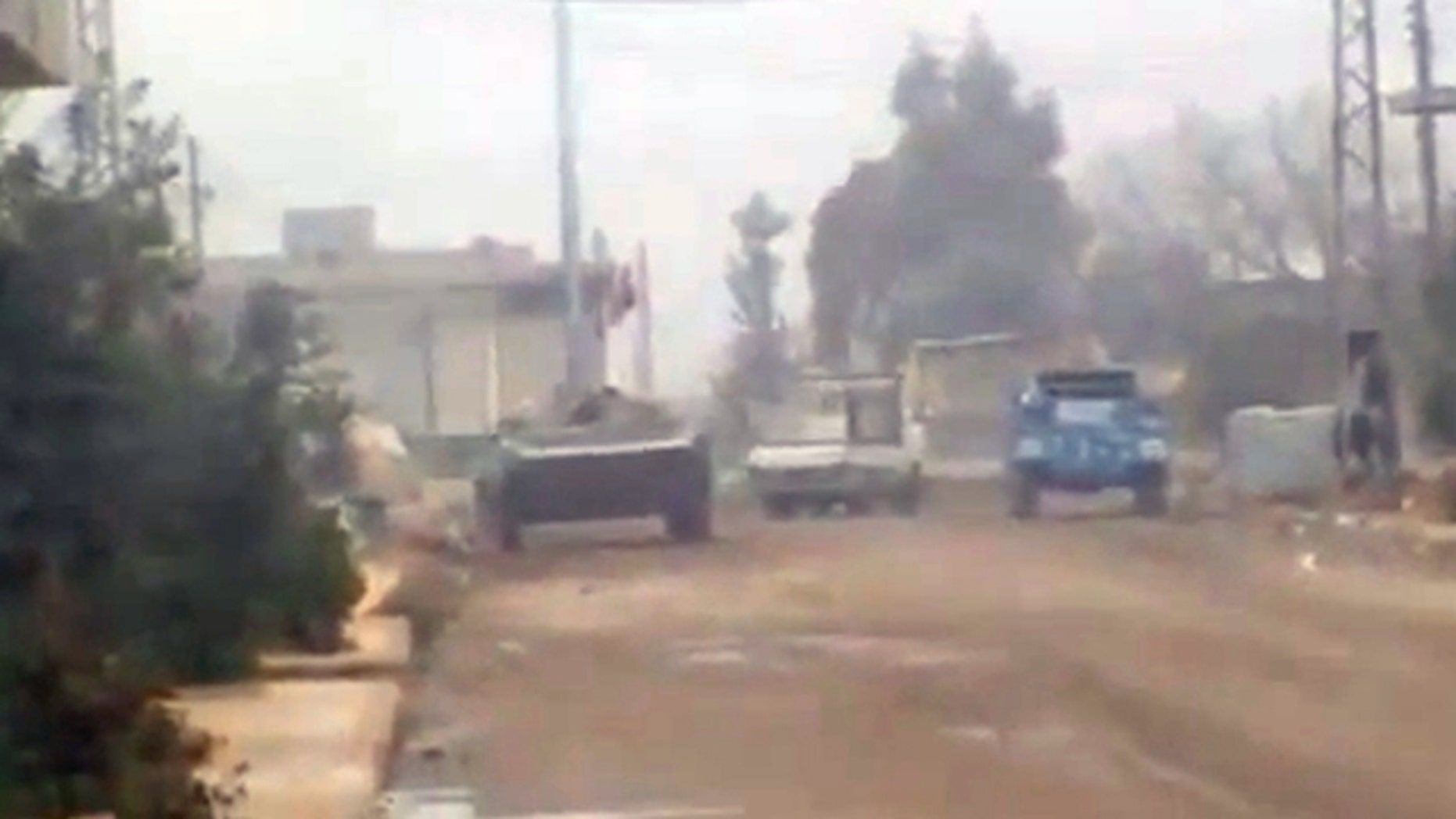 Dec. 21, 2011: In this image from amateur video made available by the Ugarit News group purports to show military vehicles in Homs, Syria.
