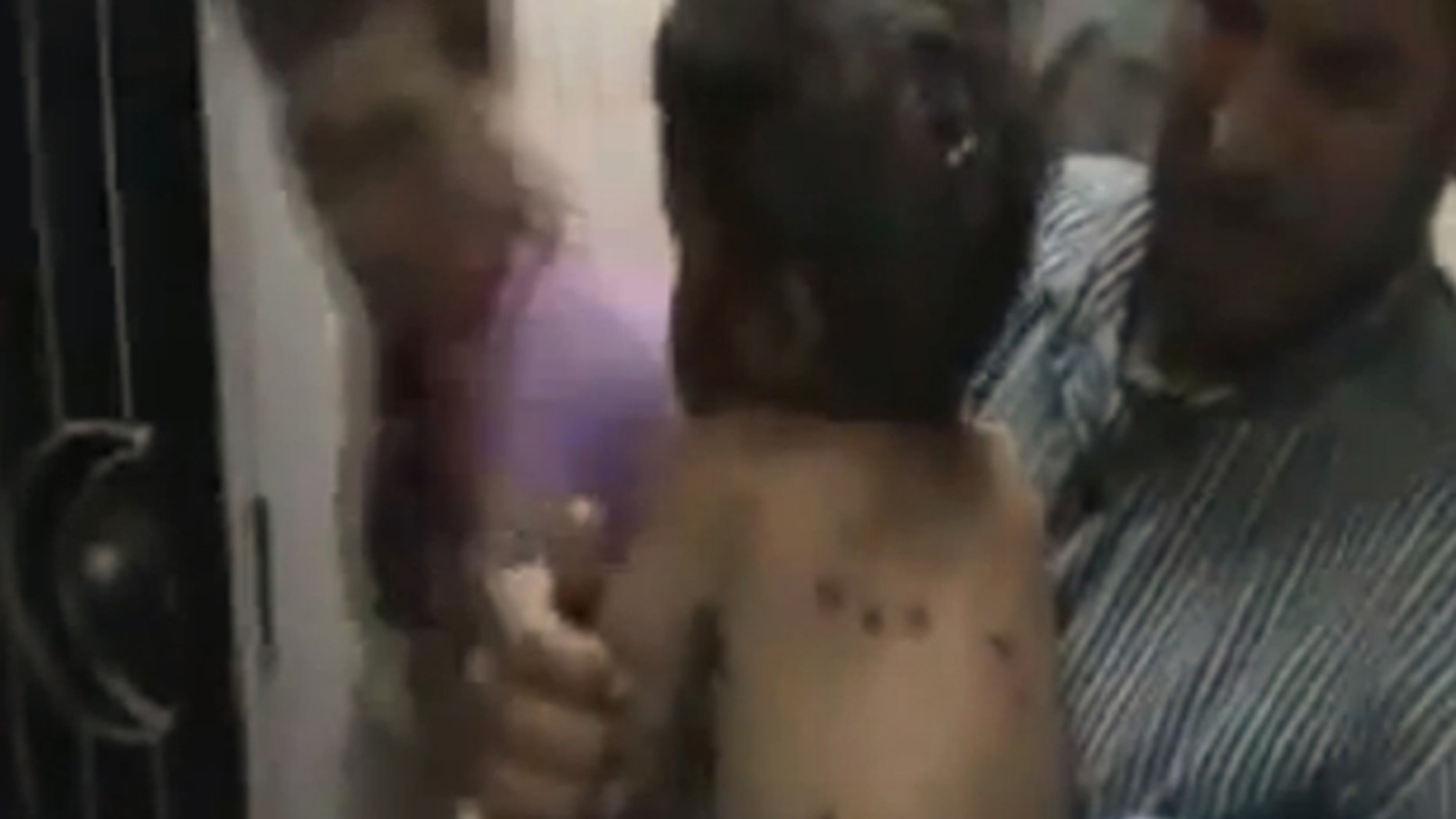 This image made from amateur video released by Shaam News Network and accessed Saturday, May 26, 2012 purports to show an injured child in Houla, Syria.