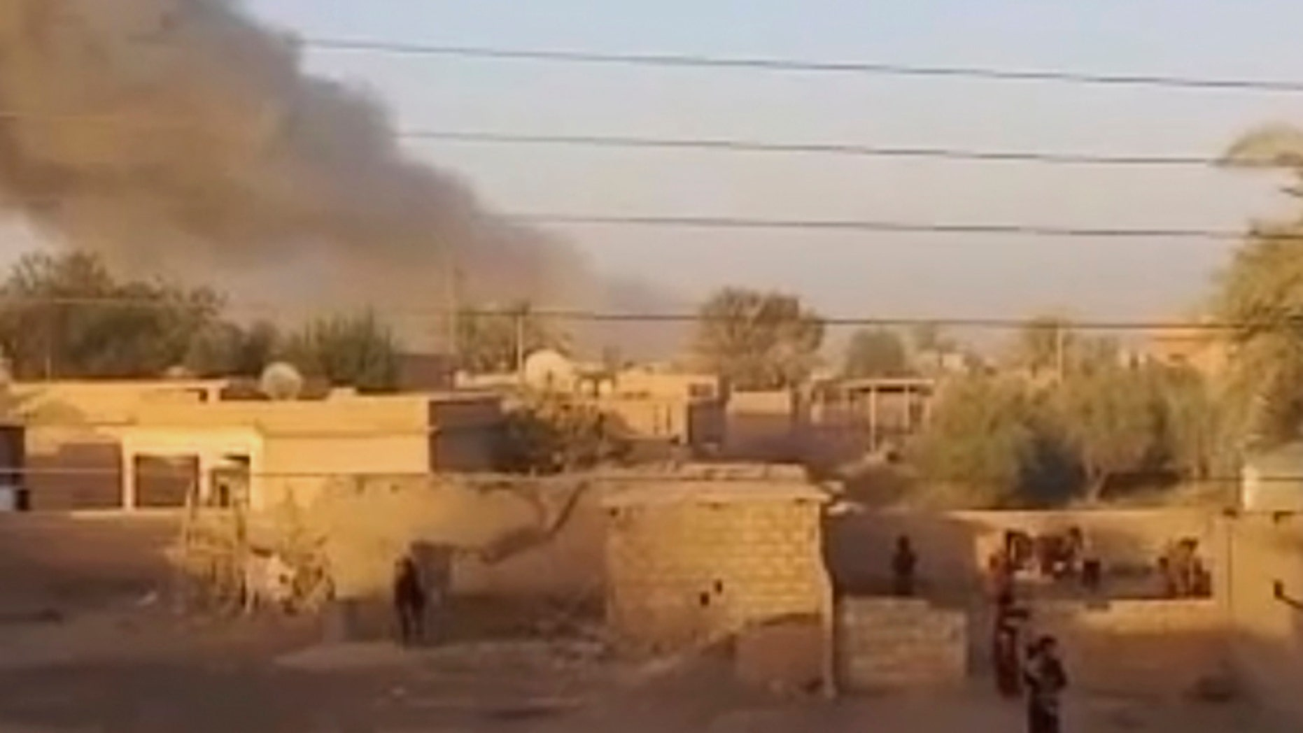 This image made from video provided by Deir Press Network and accessed by AP video on Thursday, Aug. 23, 2012 purports to show smoke rising after a bombing in Deir El-Zour, Syria.