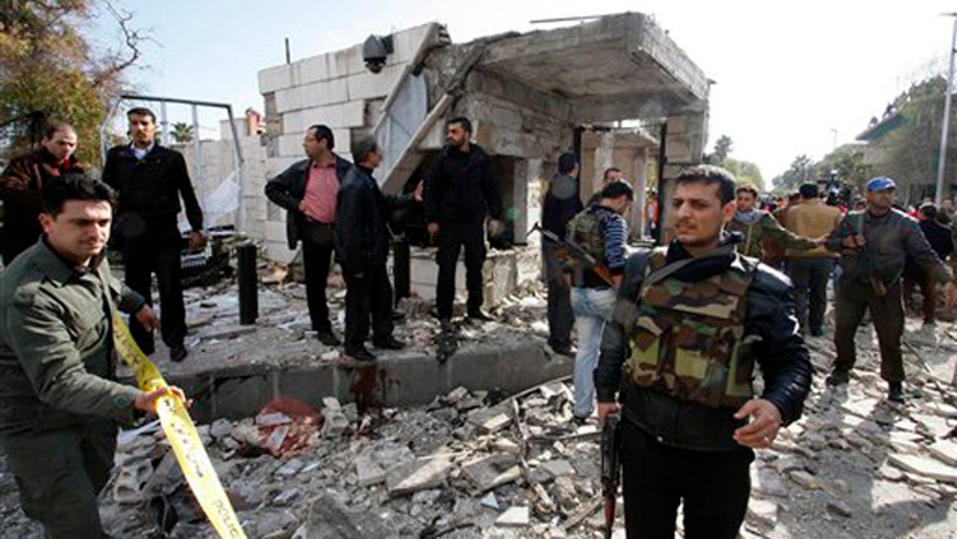 Dec. 23, 2011: Members of Syrian security are seen at the site of a suicide bombing in Damascus, Syria.